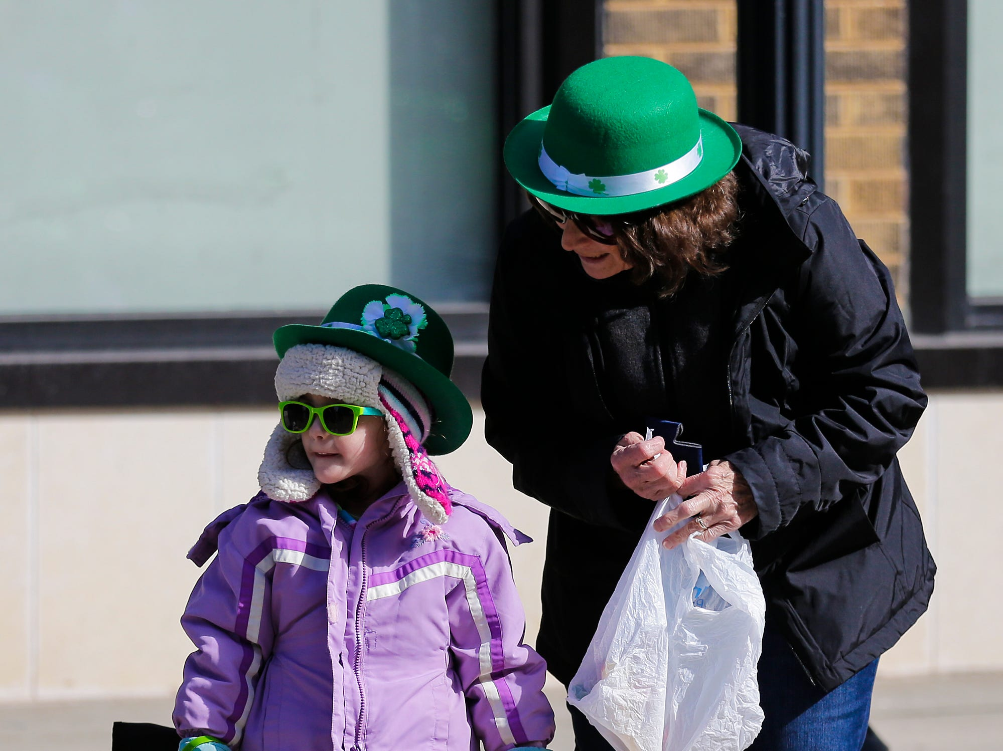 Madilynn Beuchel and Linda Kollmann watch the City of Fond du Lac St. Patrick's Day Parade Saturday, March 16, 2019 on Main Street in downtown Fond du Lac. Hundreds of people lined the street to watch over 50 parade participants. Doug Raflik/USA TODAY NETWORK-Wisconsin