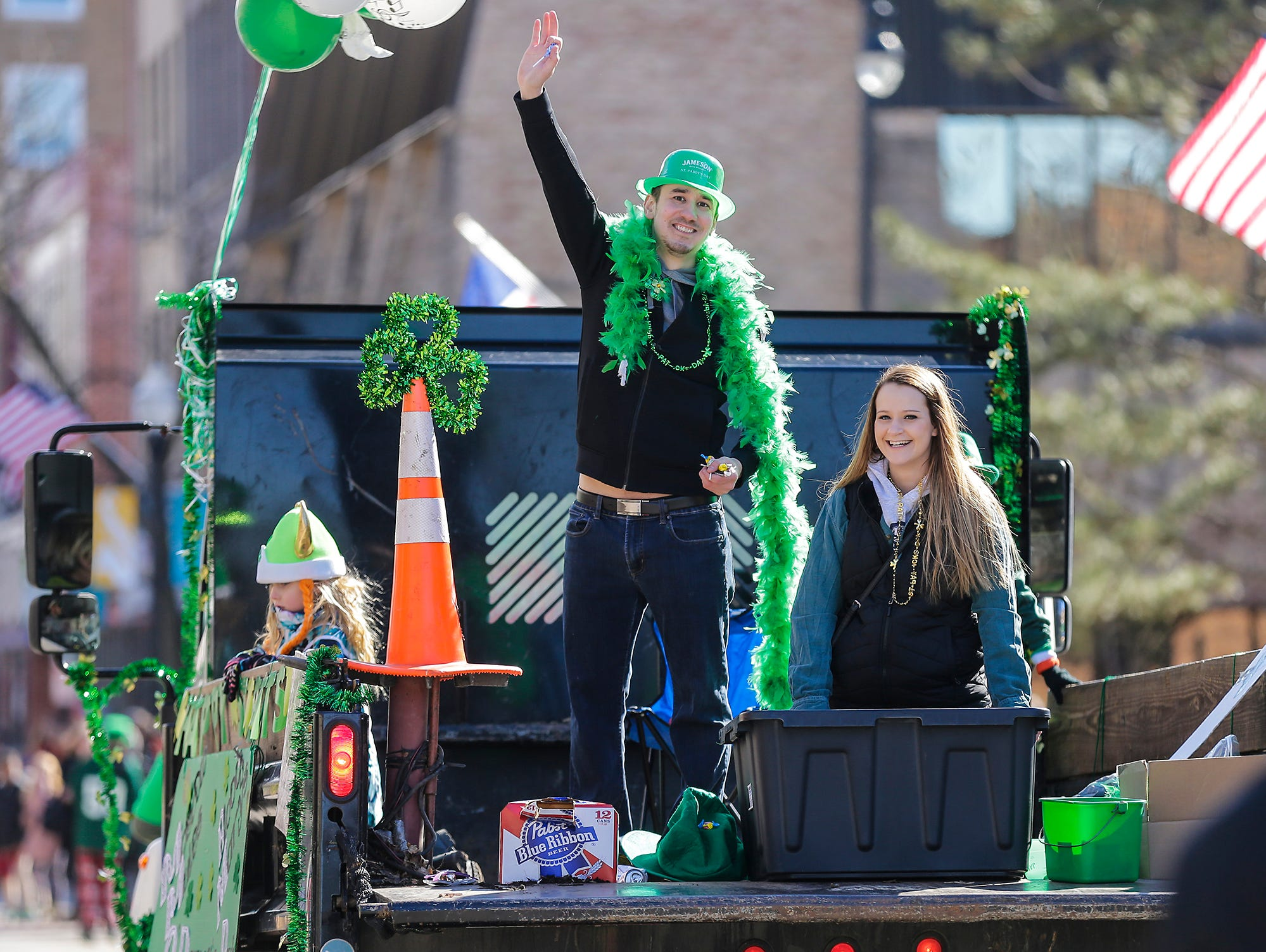 Arthur Deleon and Arianna Amend ride in the Lawn Boy/O'Davey's Pub float in the City of Fond du Lac St. Patrick's Day Parade Saturday, March 16, 2019 on Main Street in downtown Fond du Lac. Hundreds of people lined the street to watch over 50 parade participants. Doug Raflik/USA TODAY NETWORK-Wisconsin