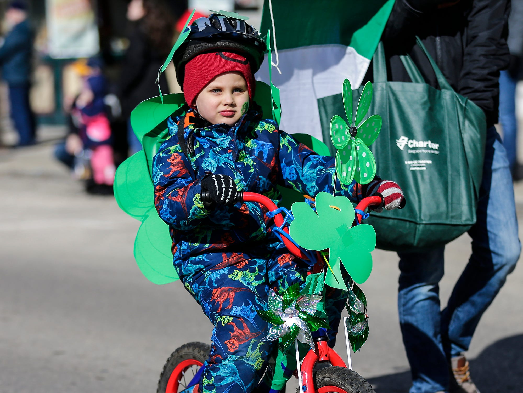 Jackson O'Hearn rides a bike in the City of Fond du Lac St. Patrick's Day Parade Saturday, March 16, 2019 on Main Street in downtown Fond du Lac. Hundreds of people lined the street to watch over 50 parade participants. Doug Raflik/USA TODAY NETWORK-Wisconsin