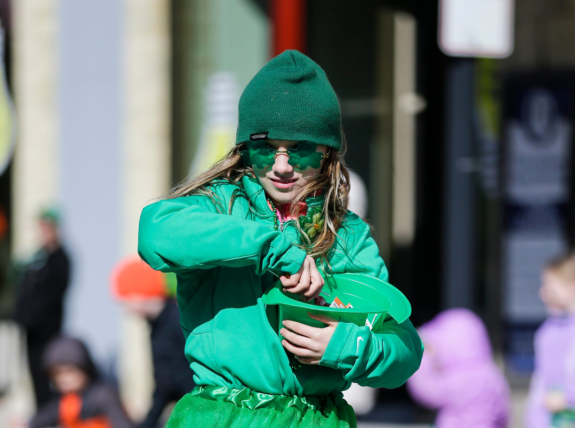 Sophia Deleon of Fond du Lac hands out candy in the City of Fond du Lac St. Patrick's Day Parade Saturday, March 16, 2019 on Main Street in downtown Fond du Lac. Hundreds of people lined the street to watch over 50 parade participants. Doug Raflik/USA TODAY NETWORK-Wisconsin