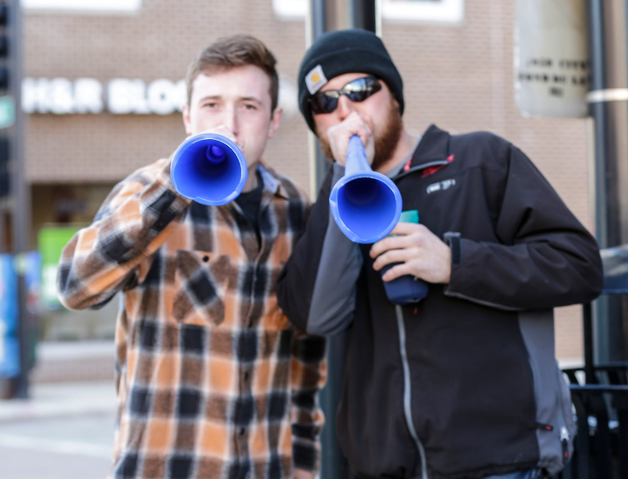 Chase Koenigs and Mitchel Oberbo blow horns as they watch the City of Fond du Lac St. Patrick's Day Parade Saturday, March 16, 2019 on Main Street in downtown Fond du Lac. Hundreds of people lined the street to watch over 50 parade participants. Doug Raflik/USA TODAY NETWORK-Wisconsin