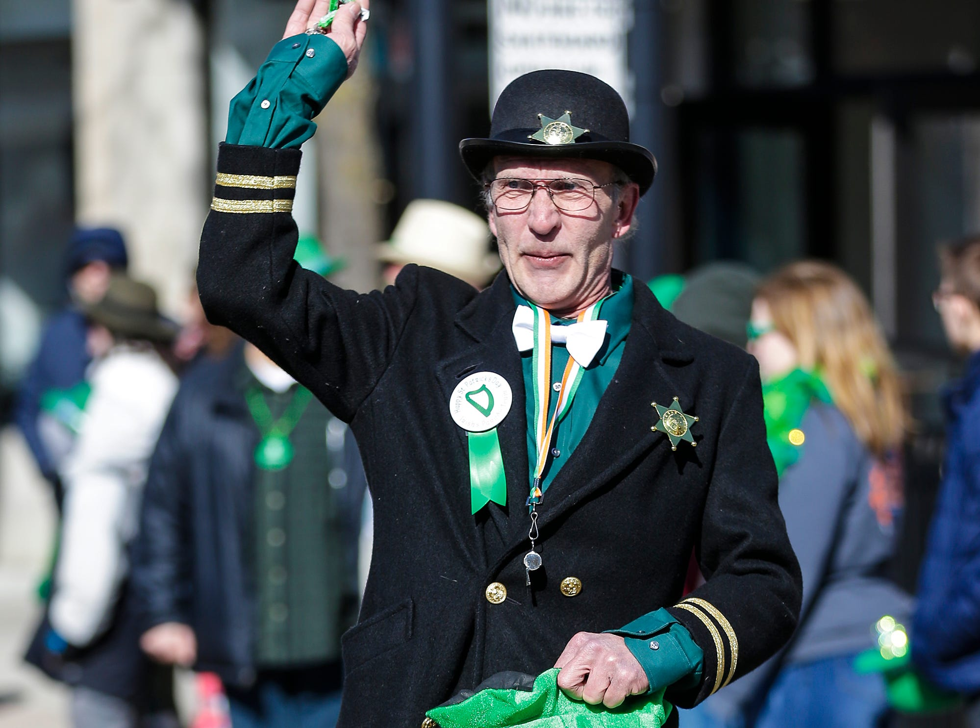Terry Gruel walks with the Irish's Bar float in the City of Fond du Lac St. Patrick's Day Parade Saturday, March 16, 2019 on Main Street in downtown Fond du Lac. Hundreds of people lined the street to watch over 50 parade participants. Doug Raflik/USA TODAY NETWORK-Wisconsin