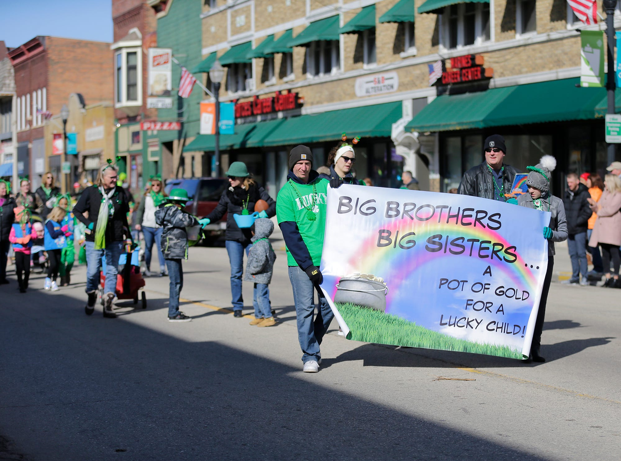 Big Brothers Big Sisters of Fond du Lac participated in the City of Fond du Lac St. Patrick's Day Parade Saturday, March 16, 2019 on Main Street in downtown Fond du Lac. Hundreds of people lined the street to watch over 50 parade participants. Doug Raflik/USA TODAY NETWORK-Wisconsin
