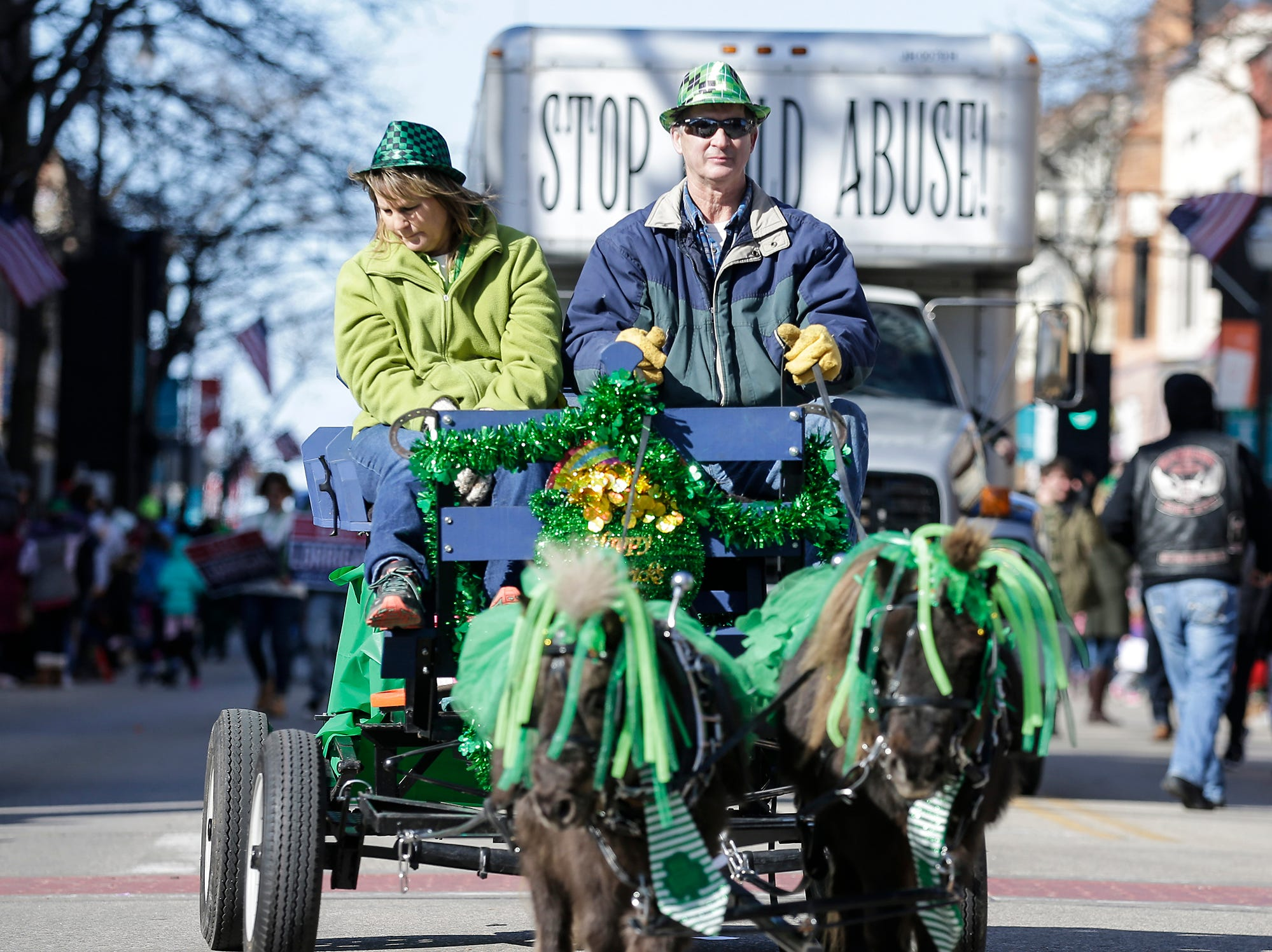 Barb and Kevin Statdmueller get pulled by Jack and Danny in the City of Fond du Lac St. Patrick's Day Parade Saturday, March 16, 2019 on Main Street in downtown Fond du Lac. Hundreds of people lined the street to watch over 50 parade participants. Doug Raflik/USA TODAY NETWORK-Wisconsin