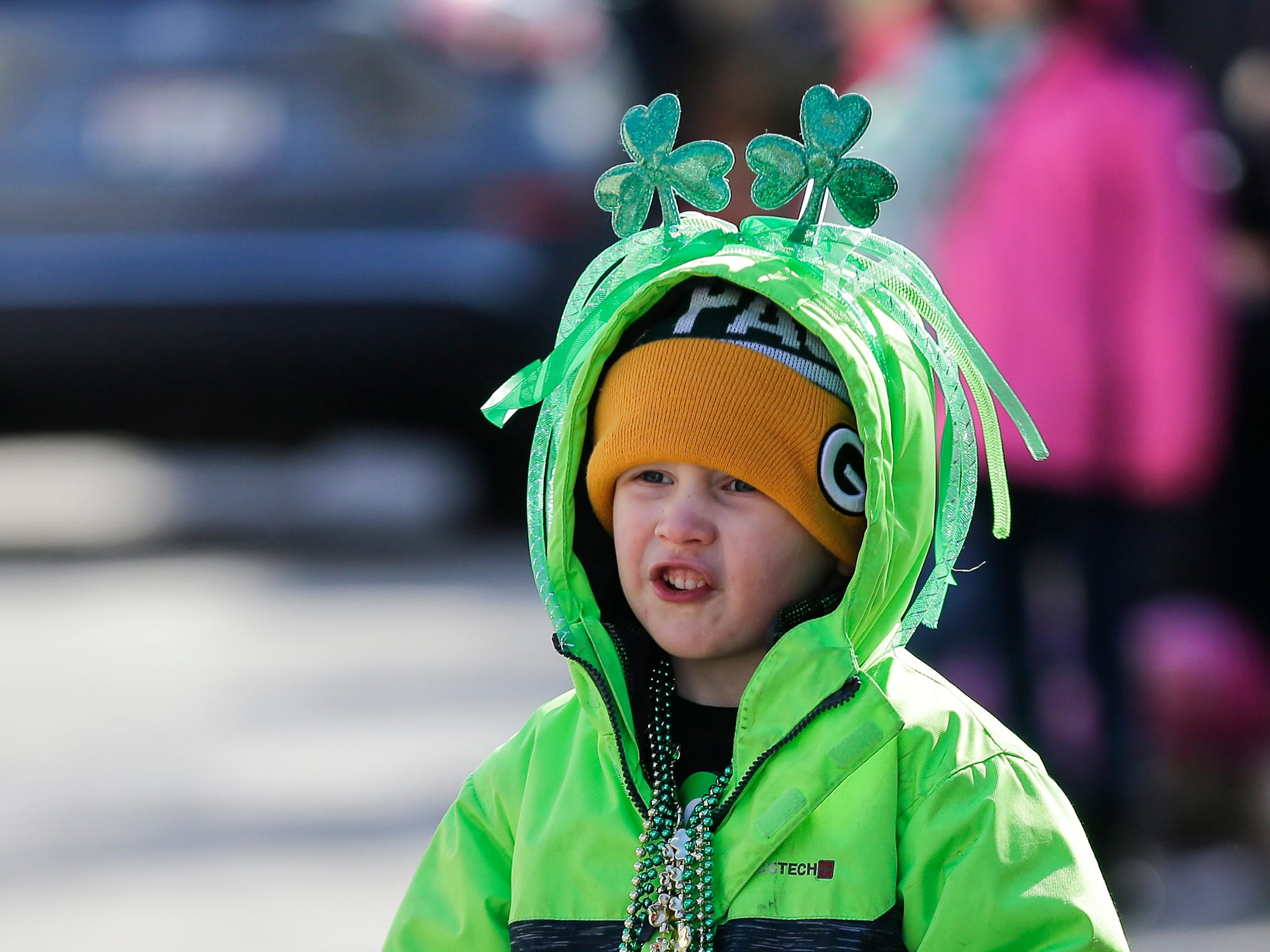 Gabe Holden waits for candy to be thrown during the City of Fond du Lac St. Patrick's Day Parade Saturday, March 16, 2019 on Main Street in downtown Fond du Lac. Hundreds of people lined the street to watch over 50 parade participants. Doug Raflik/USA TODAY NETWORK-Wisconsin