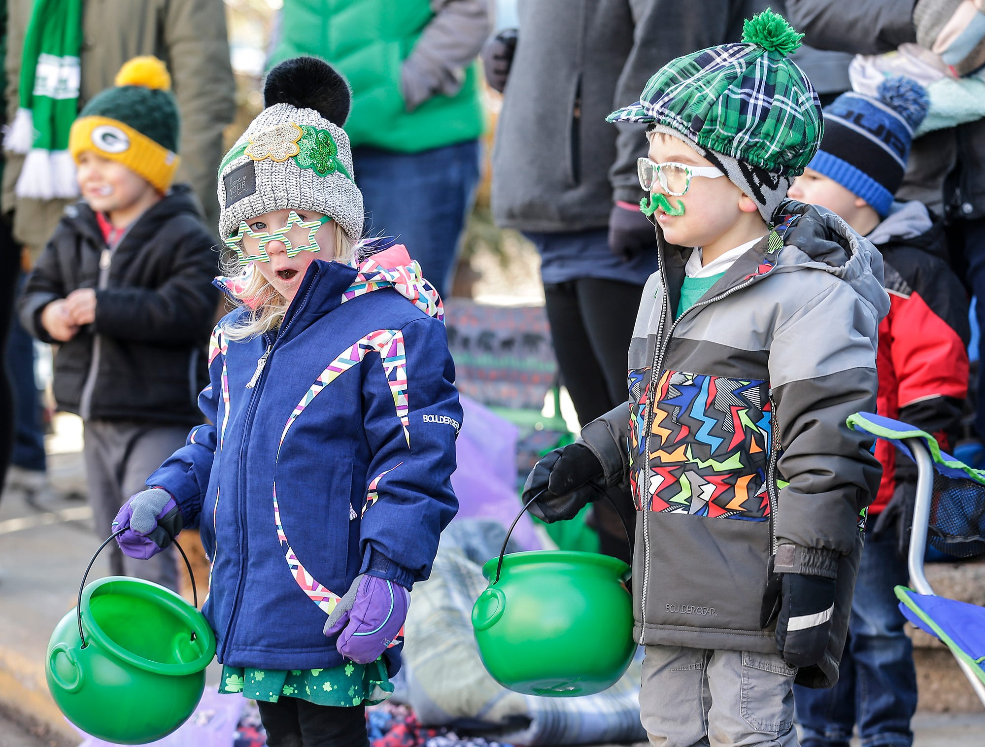 Jovie and Tye Zimmerman watch the City of Fond du Lac St. Patrick's Day Parade Saturday, March 16, 2019 on Main Street in downtown Fond du Lac. Hundreds of people lined the street to watch over 50 parade participants. Doug Raflik/USA TODAY NETWORK-Wisconsin
