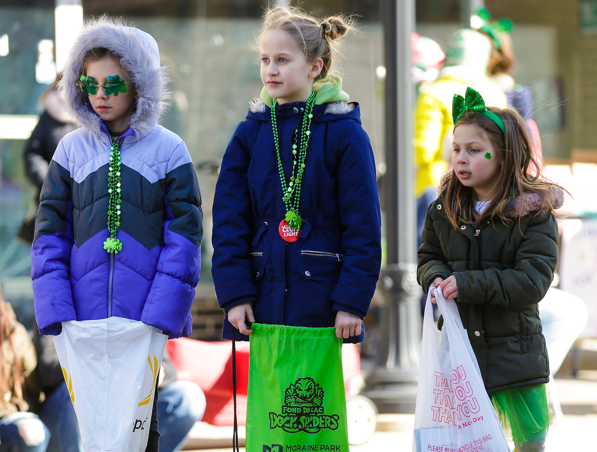 Ava Duran, Emma Klapperich and Lilly Lindgren watch the City of Fond du Lac St. Patrick's Day Parade Saturday, March 16, 2019 on Main Street in downtown Fond du Lac. Hundreds of people lined the street to watch over 50 parade participants. Doug Raflik/USA TODAY NETWORK-Wisconsin