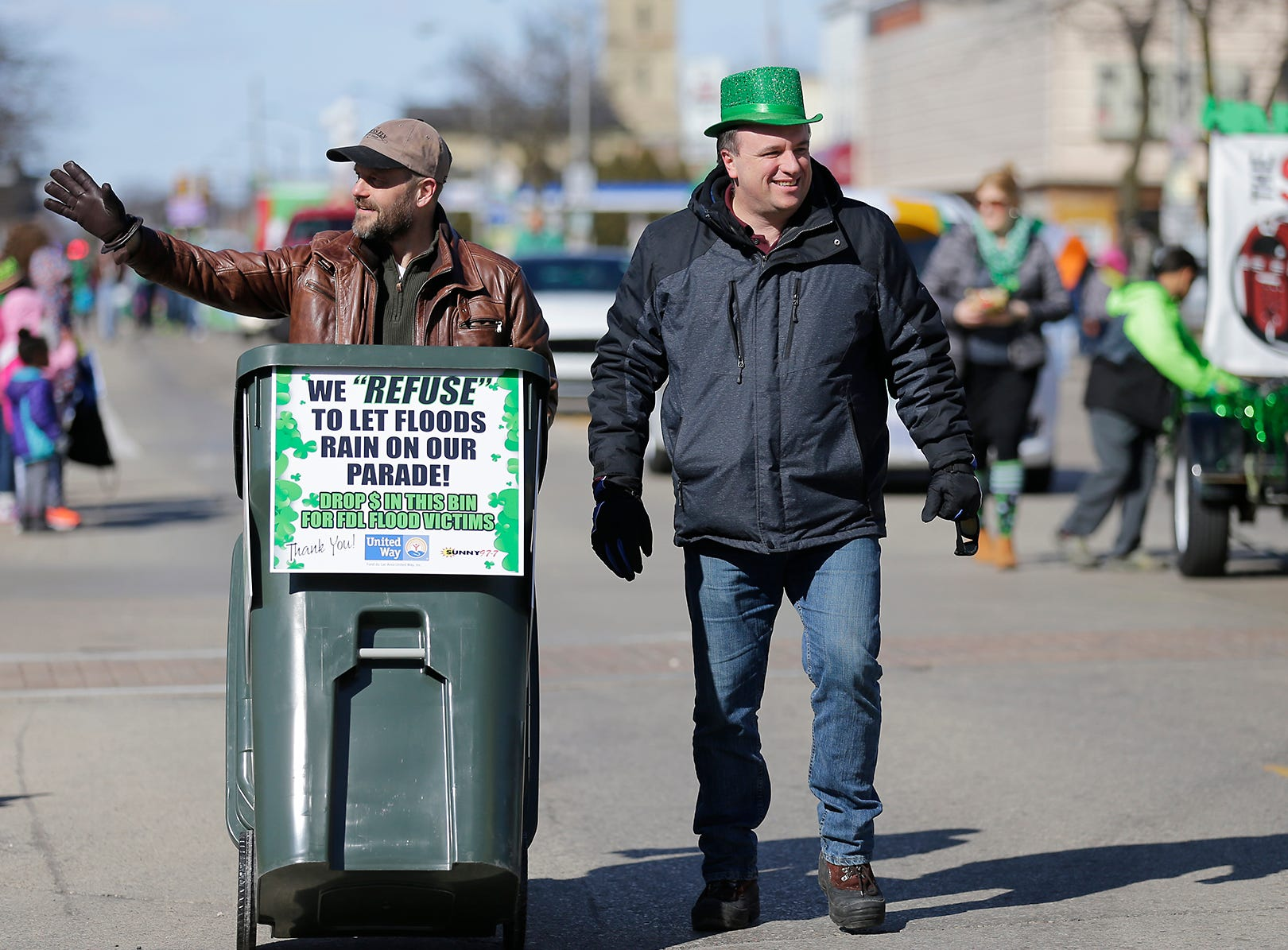 Greg Stensland and Ron Jacobson collect money for flood victims during the City of Fond du Lac St. Patrick's Day Parade Saturday, March 16, 2019 on Main Street in downtown Fond du Lac. Hundreds of people lined the street to watch over 50 parade participants. Doug Raflik/USA TODAY NETWORK-Wisconsin