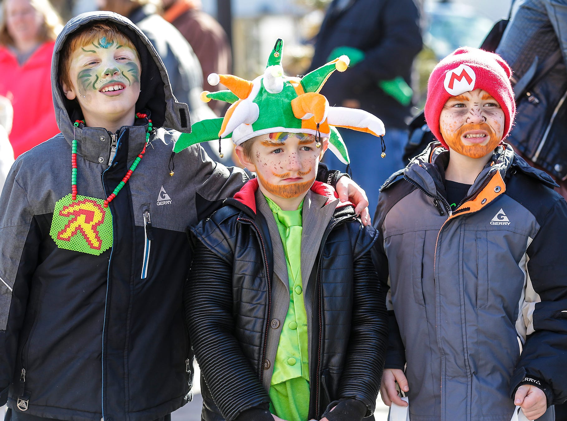 Connor, Wyatt and Dexter Rady of Fond du Lac watch the City of Fond du Lac St. Patrick's Day Parade Saturday, March 16, 2019 on Main Street in downtown Fond du Lac. Hundreds of people lined the street to watch over 50 parade participants. Doug Raflik/USA TODAY NETWORK-Wisconsin