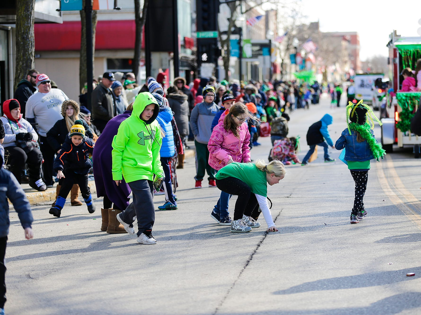 Hundreds of people lined the street Saturday; March 16; 2019 on Main Street in downtown Fond du Lac to watch the City of Fond du Lac St. Patrick's Day Parade .; Doug Raflik/USA TODAY NETWORK-Wisconsin