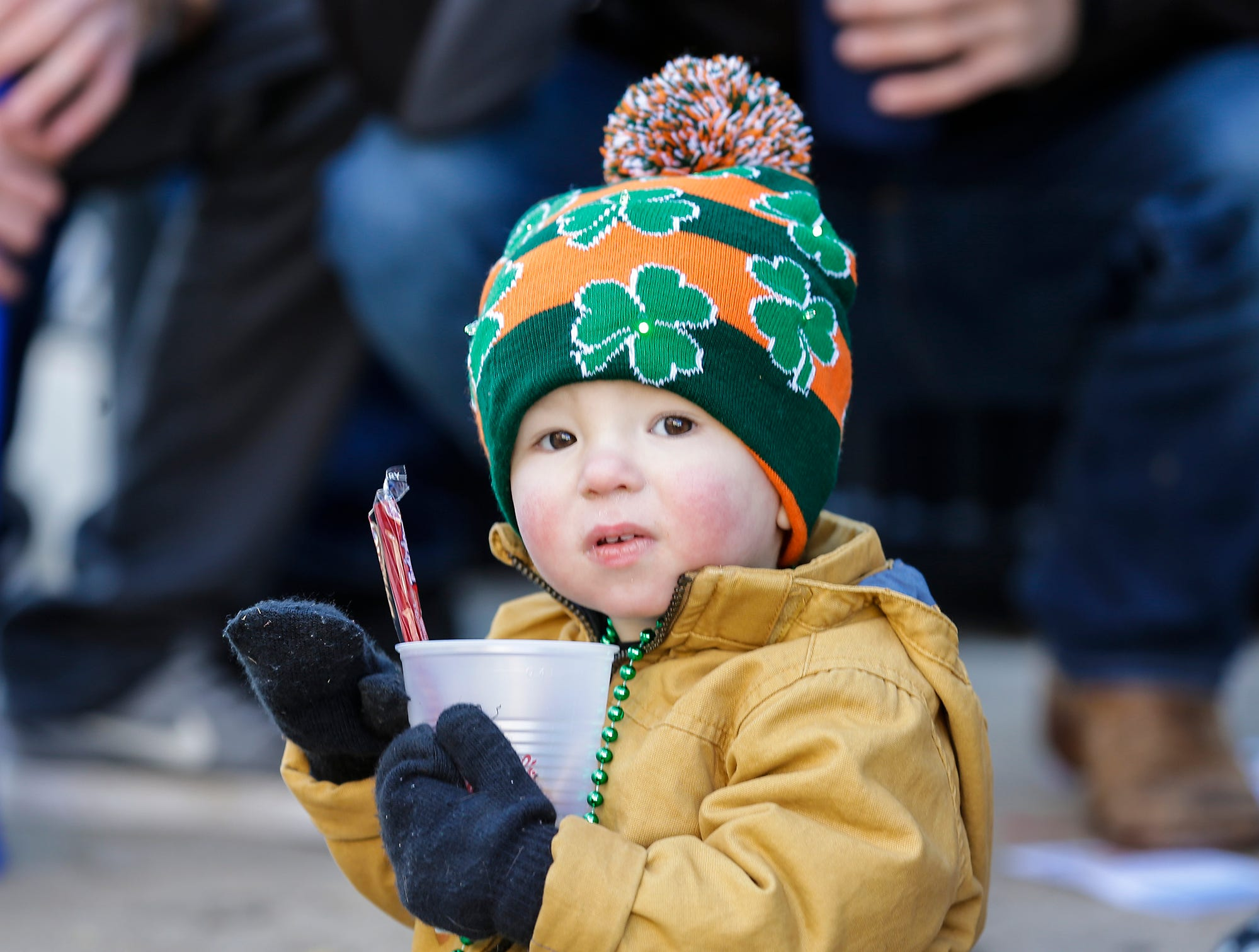 Cameron Torgersen watches the City of Fond du Lac St. Patrick's Day Parade Saturday, March 16, 2019 on Main Street in downtown Fond du Lac. Hundreds of people lined the street to watch over 50 parade participants. Doug Raflik/USA TODAY NETWORK-Wisconsin