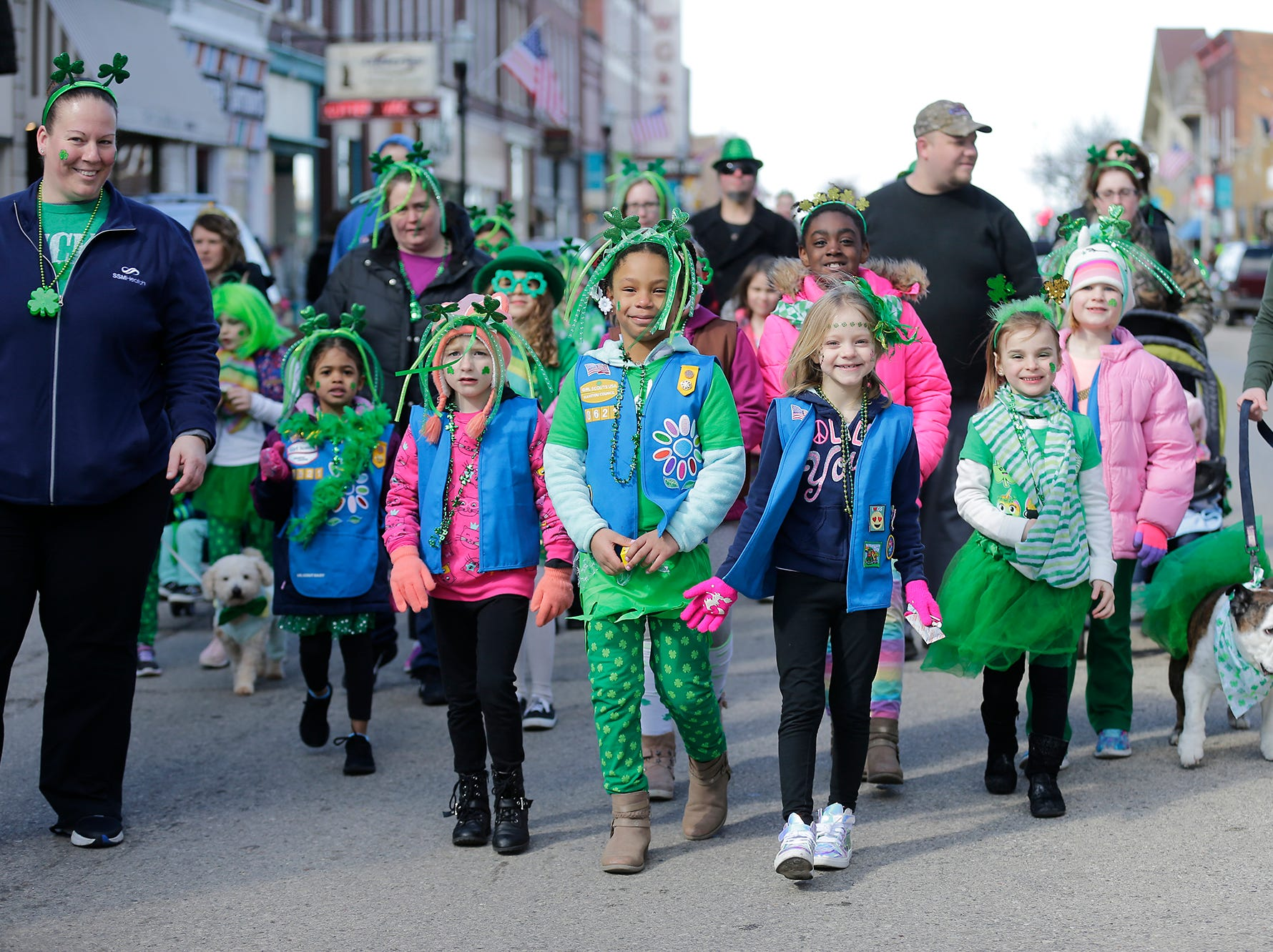 Rosenow Elementary School Girl Scouts participated in the City of Fond du Lac St. Patrick's Day Parade Saturday, March 16, 2019 on Main Street in downtown Fond du Lac. Hundreds of people lined the street to watch over 50 parade participants. Doug Raflik/USA TODAY NETWORK-Wisconsin