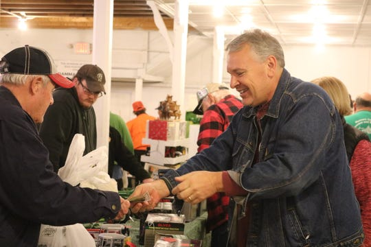 Brad Bergefurd, right, makes a sale of a vintage Oliver toy tractor during the 33rd annual Fremont Toy Show on Saturday.