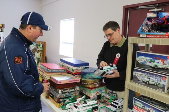 Randy Ohms, right, speaks with a customer about a vintage Hess toy during the 33rd annual Fremont Toy Show on Saturday.