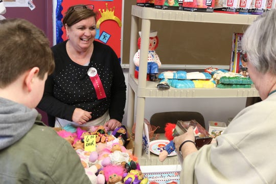 Lu Anne Ohms, left, speaks with a few customers during the 33rd annual Fremont Toy Show on Saturday.