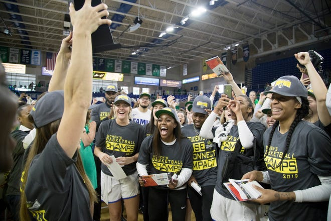 FGCU's players celebrate beating Liberty 72-49 in the ASUN Women's Basketball Championship game on Sunday at Alico Arena in Fort Myers.