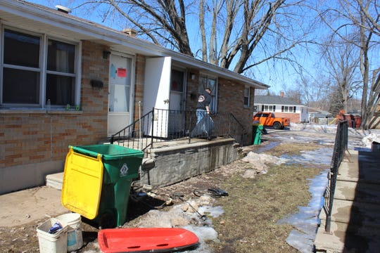 A cleanup crew removes damaged property from an apartment building at 1554 Cass St. in Green Bay.