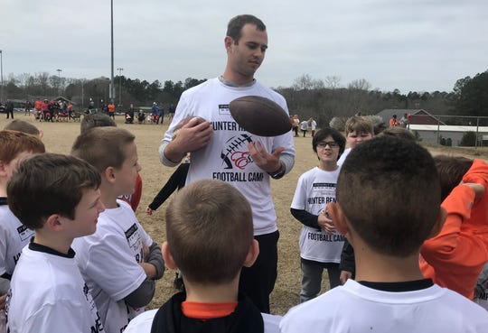 Former Clemson wide receiver Hunter Renfrow greets kids at his youth football camp Saturday afternoon at Clemson's Nettles Park.