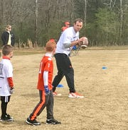 Hunter Renfrow works with youngsters as his football camp at Clemson's Nettles Park on Saturday.