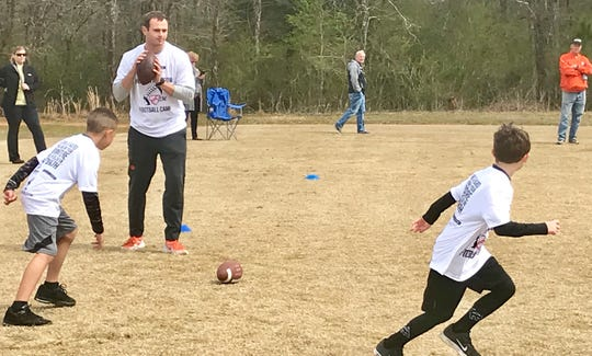 Hunter Renfrow puts campers through pass-catching drills Saturday.