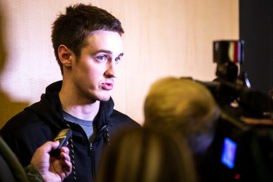 Iowa forward Nicholas Baer speaks to reporters on Sunday, March 17, 2019, at Carver-Hawkeye Arena in Iowa City, Iowa.