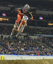 Marvin Musquin (25) maintains his lead over the field in the 450SX main event. The AMA Supercross, an FIM World Championship event came to Lucas Oil Stadium, Saturday, March 16, 2019. Twenty-two riders competed in the main event - the 450SX class.