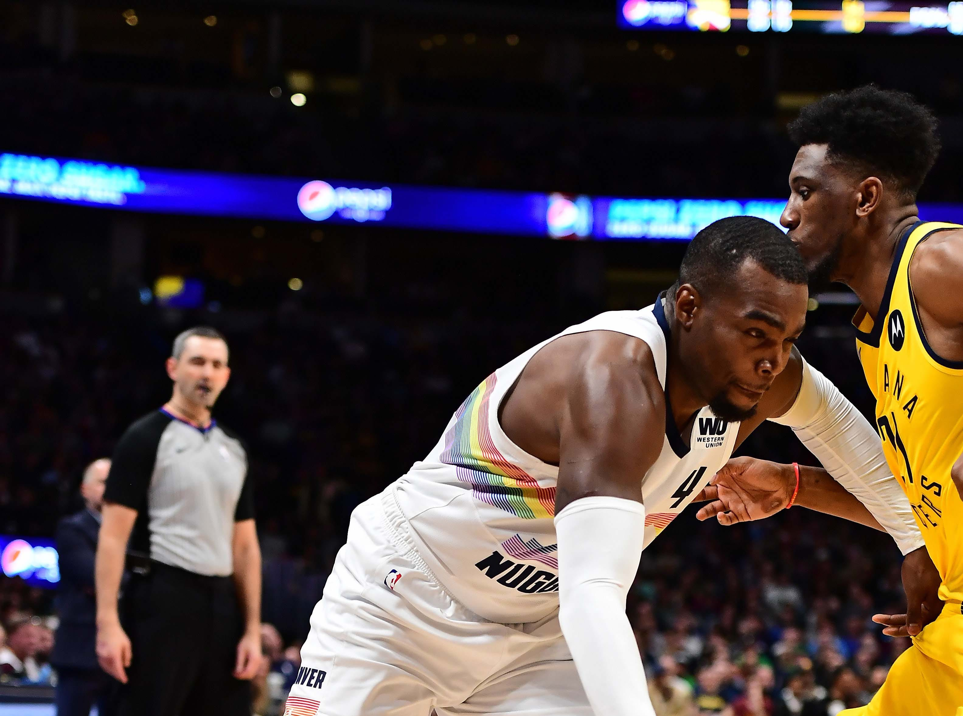 Mar 16, 2019; Denver, CO, USA; Denver Nuggets forward Paul Millsap (4) dribbles at Indiana Pacers forward Thaddeus Young (21) in the second quarter at the Pepsi Center. Mandatory Credit: Ron Chenoy-USA TODAY Sports