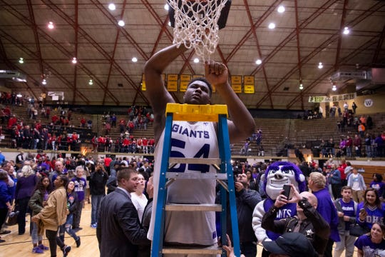 Ben Davis's Dawand Jones (54) dust down the net after beating Center Grove in the 4A Boys Indiana Semi-State Basketball Tournament at the Hatchet House in Washington, Ind., Saturday afternoon.