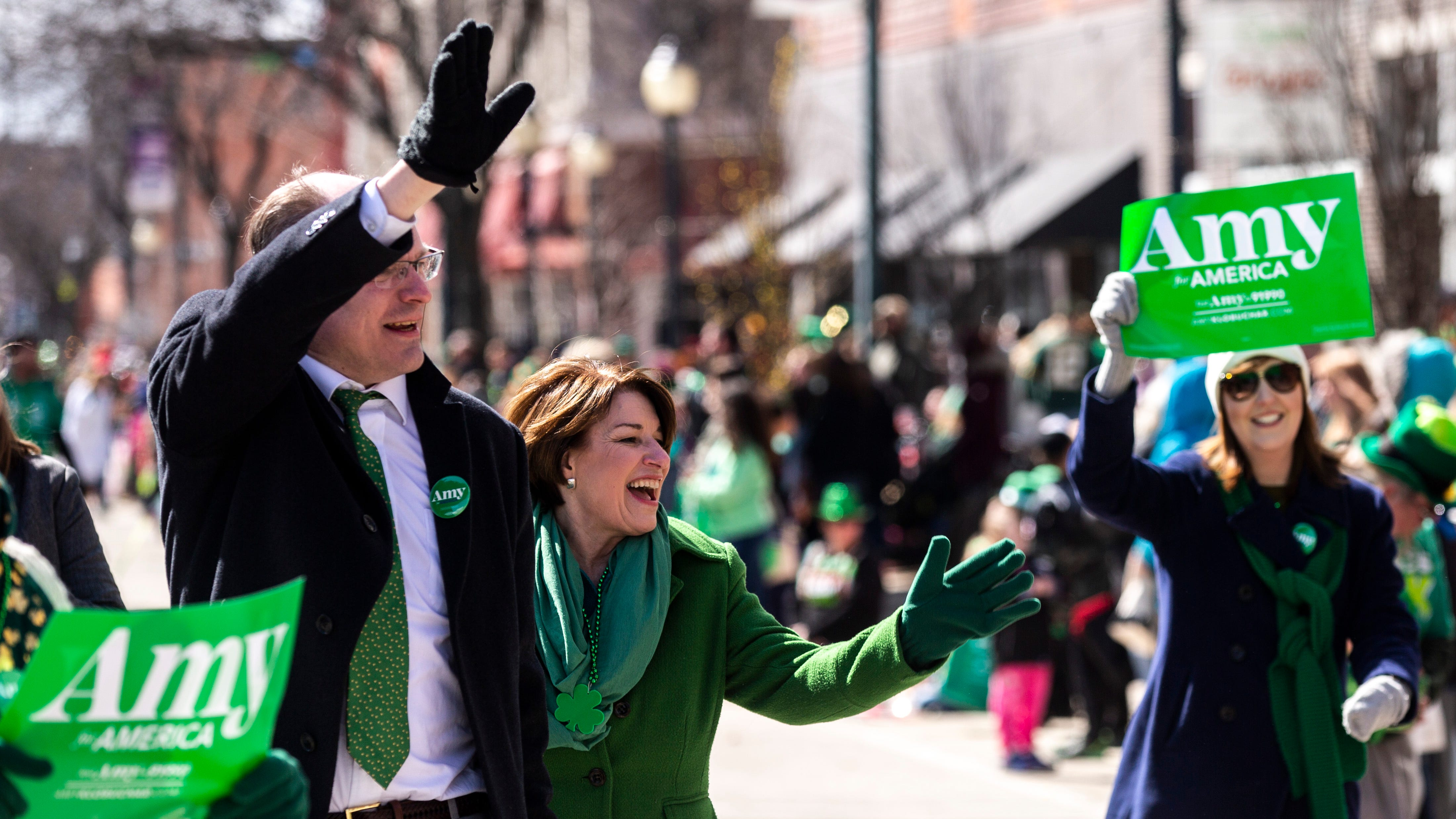 Sometimes running for president means marching in a parade — and that's just what Amy Klobuchar did in Iowa on Sunday