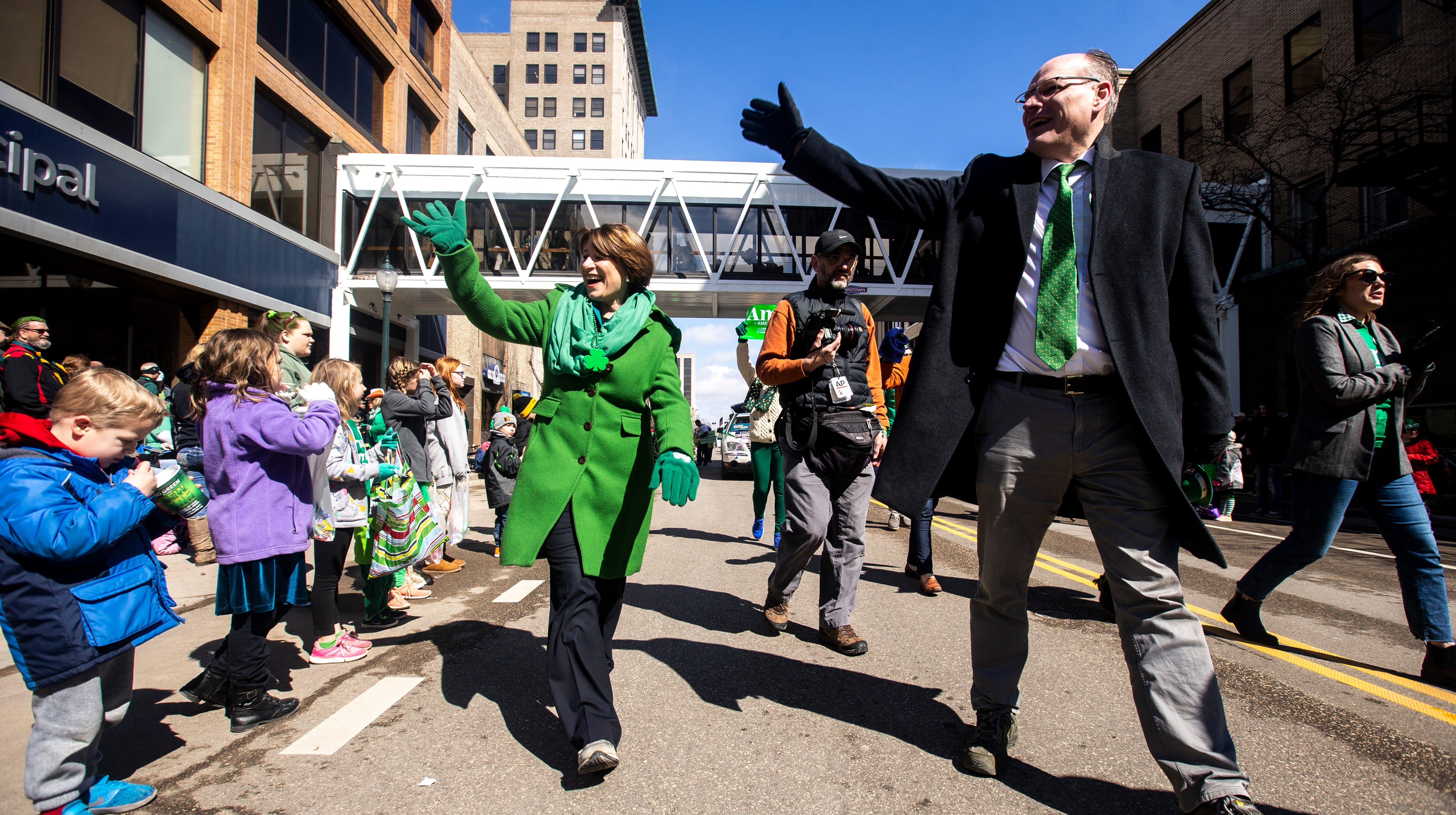 Amy Klobuchar walks St. Patrick's Day parade in Iowa