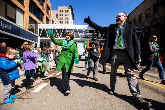 Sen. Amy Klobuchar and her husband, John Bessler, march in a parade last year. Bessler, one of the first known patients from Minnesota to recover from the novel coronavirus, is now donating his plasma as part of a national experiment.