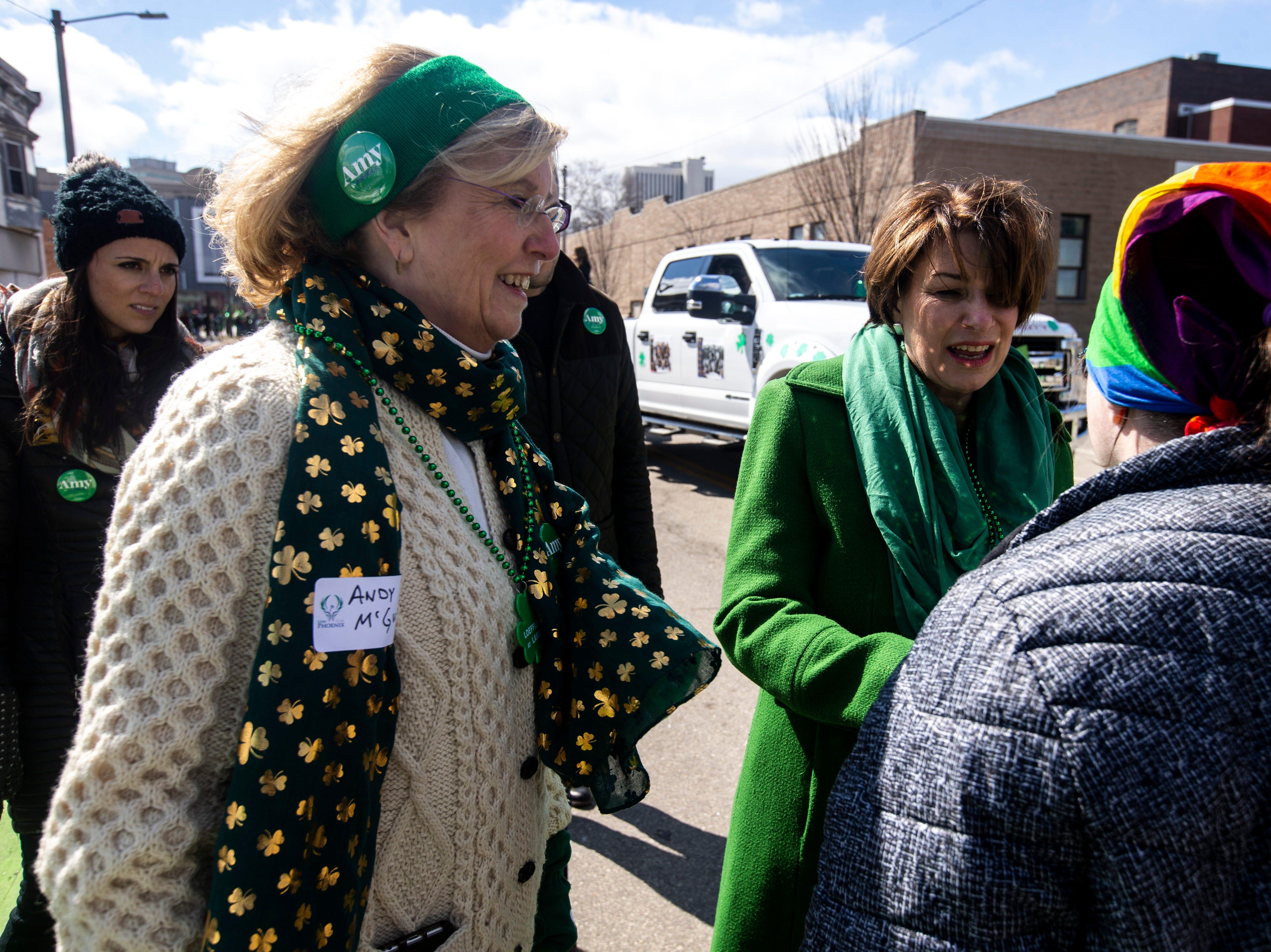 U.S. Sen. Amy Klobuchar, D-Minn., talks with residents while walking in the Saint Patrick's Day Parade Society (SaPaDaPaSo) parade on Sunday, March 17, 2019, in downtown Cedar Rapids, Iowa.