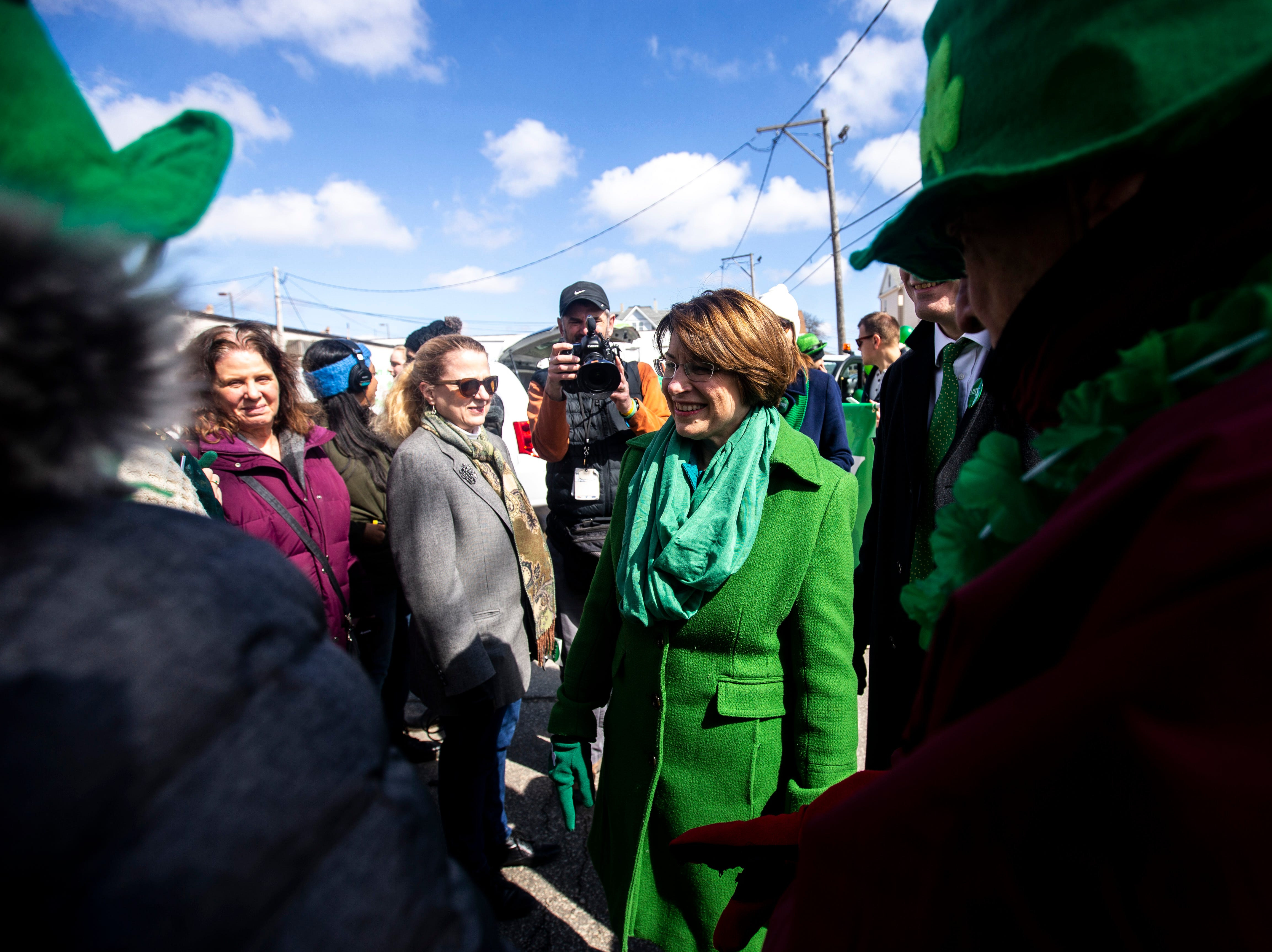 U.S. Sen. Amy Klobuchar, D-Minn., meets with members of the Linn County Democrats before walking with them in the Saint Patrick's Day Parade Society (SaPaDaPaSo) parade on Sunday, March 17, 2019, in downtown Cedar Rapids, Iowa.
