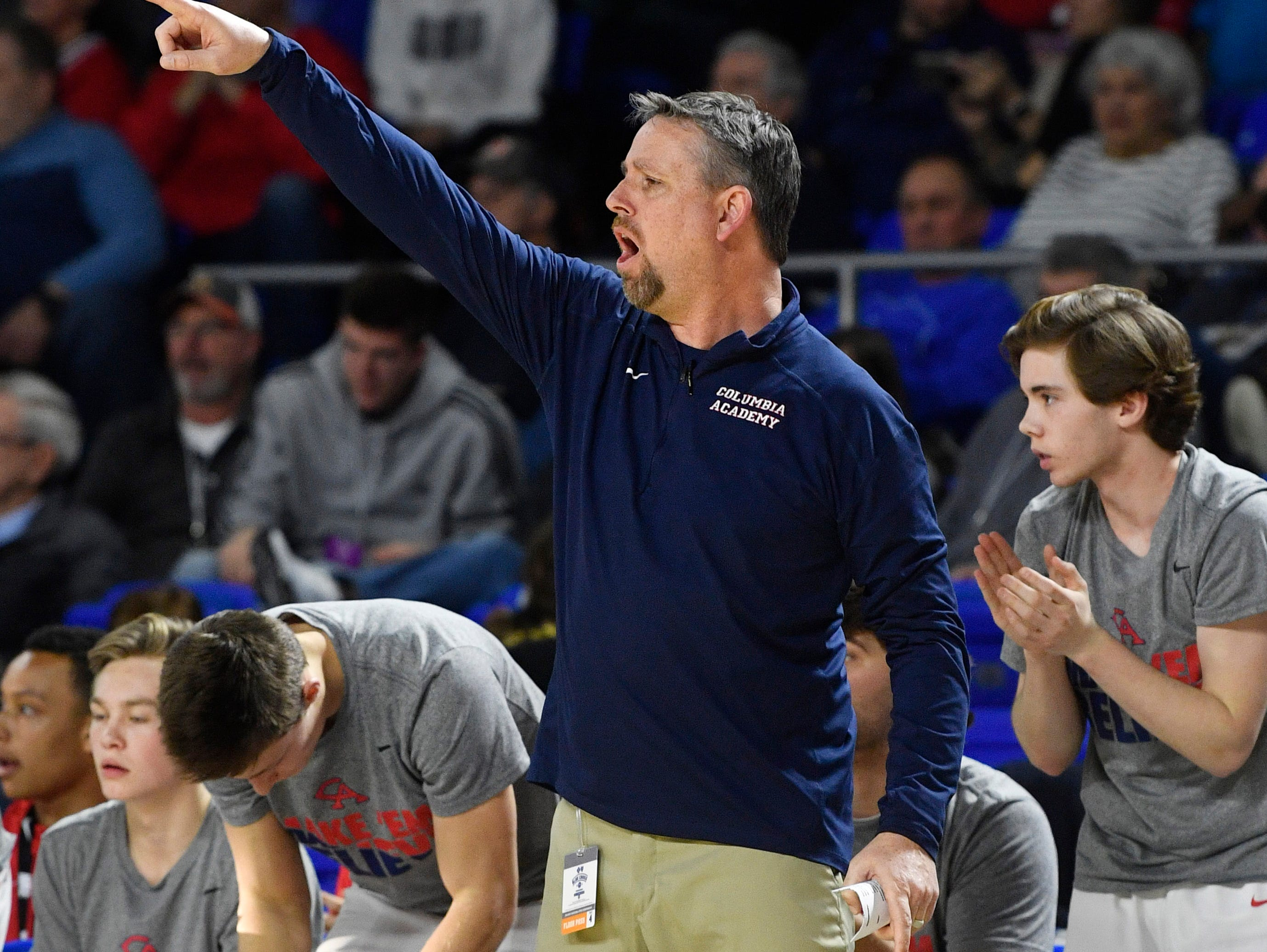 Columbia Academy head coach Marty DeJarnette instructs his players as Columbia Academy plays Humboldt for the TSSAA Class A Championship  Saturday, March 16, 2019, in Murfreesboro, Tenn.