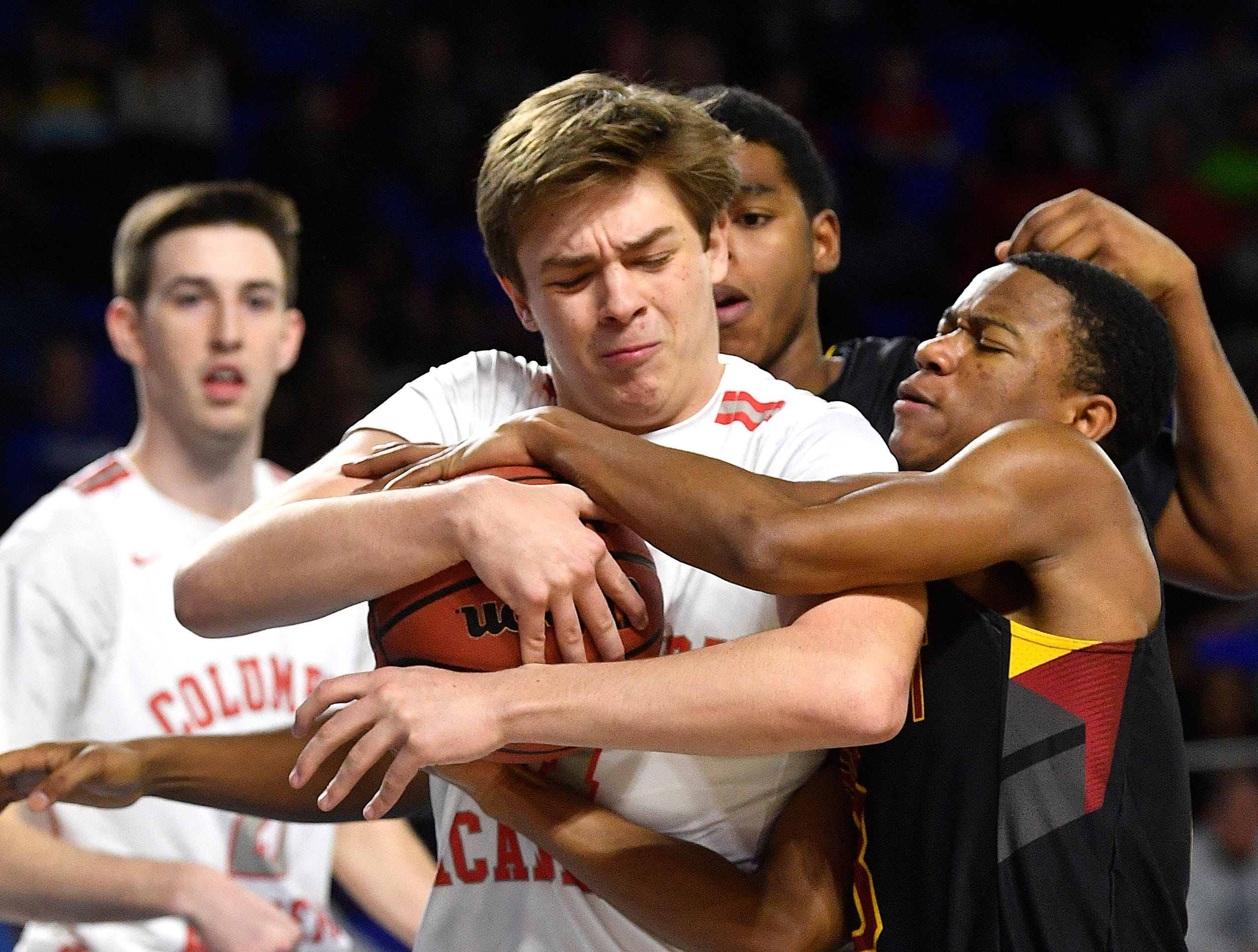 Humboldt's Trent Green (3) and Columbia Academy Gary Smith, Jr. (23) struggle for the ball as Columbia Academy plays Humboldt for the TSSAA Class A Championship  Saturday, March 16, 2019, in Murfreesboro, Tenn.