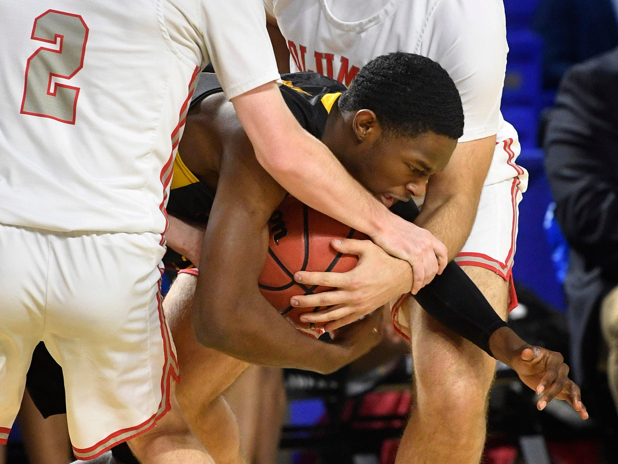 Humboldt's Ronald Abernathy (2) is squeezed by defenders as Columbia Academy plays Humboldt for the TSSAA Class A Championship  Saturday, March 16, 2019, in Murfreesboro, Tenn.