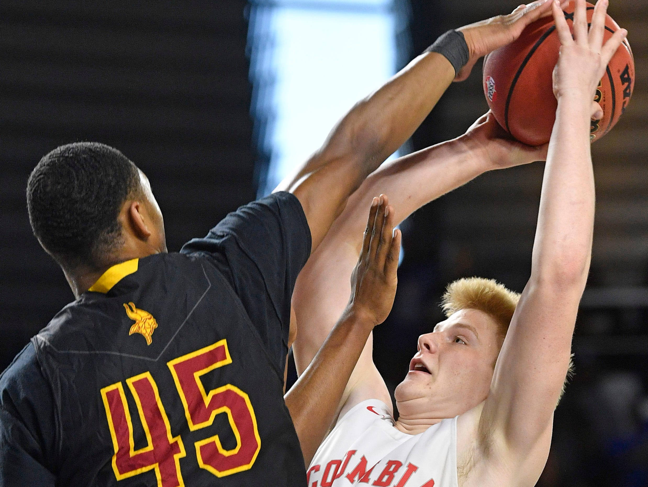 Humboldt's Anthony Jones (45) blocks a shot by Columbia Academy's Carson Cary (12) as Columbia Academy plays Humboldt for the TSSAA Class A Championship  Saturday, March 16, 2019, in Murfreesboro, Tenn.