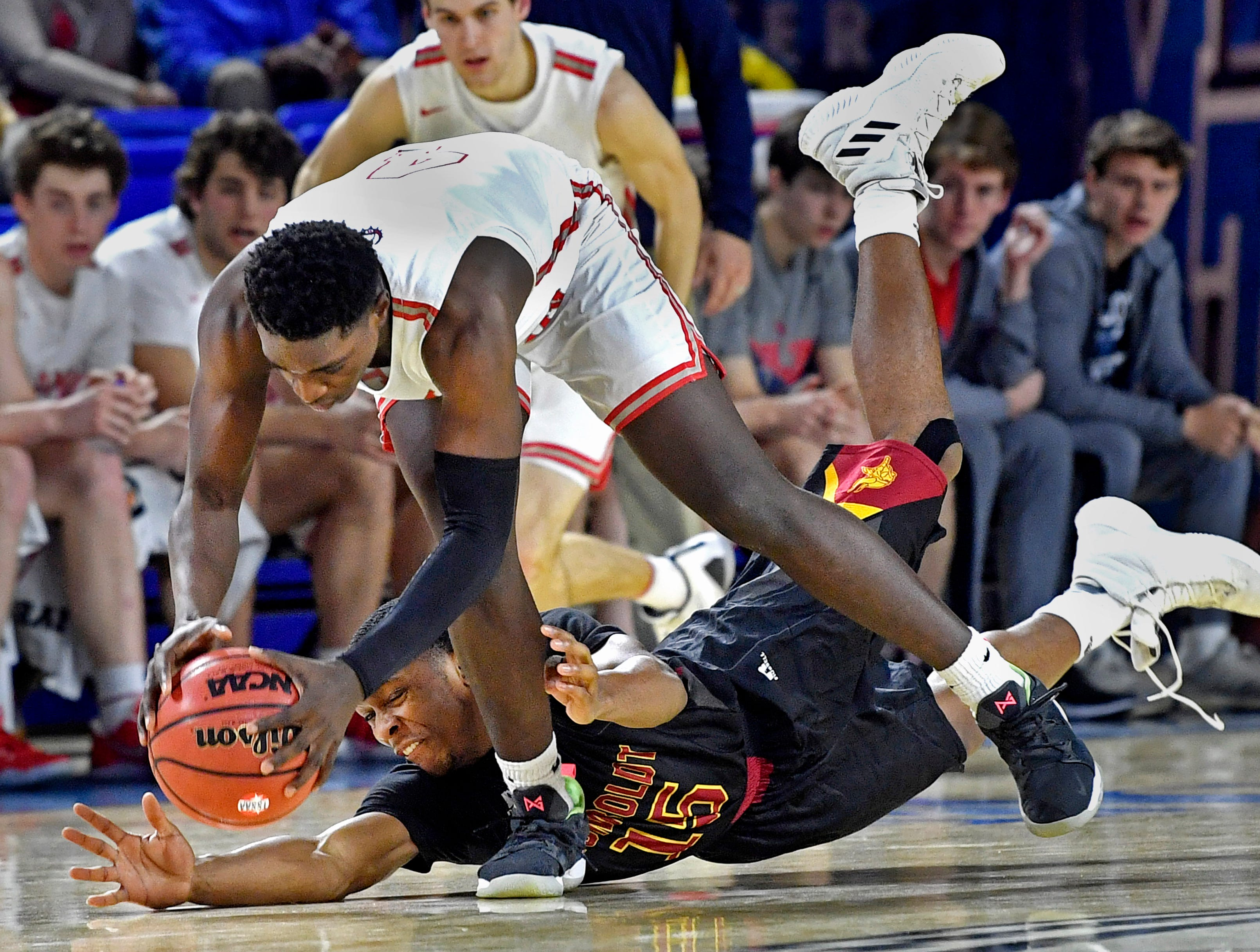 Columbia Academy Sky Polk (4) and Humboldt's Malik Cox (15) both go for a loose ball as Columbia Academy plays Humboldt for the TSSAA Class A Championship  Saturday, March 16, 2019, in Murfreesboro, Tenn.