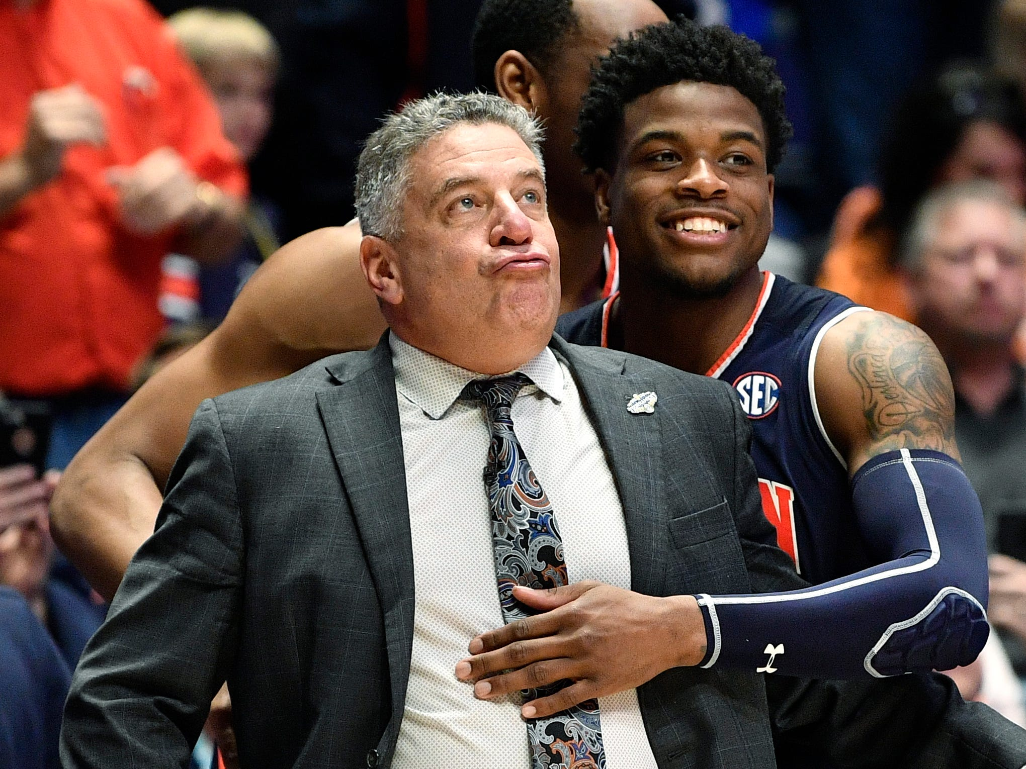 Auburn head coach Bruce Pearl and Auburn guard/forward Malik Dunbar (4) react in the closing minutes of the second half of the team's win over Tennessee in the SEC Men's Basketball Tournament championship game at Bridgestone Arena in Nashville, Tenn., Sunday, March 17, 2019.