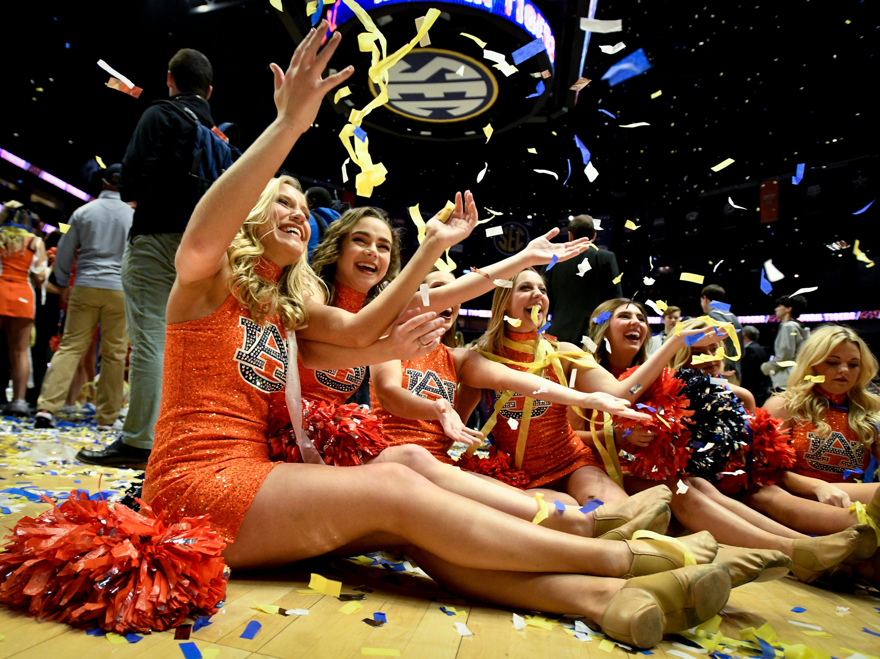 The Auburn dance team celebrates after their SEC Men's Basketball Tournament championship victory against Tennessee at Bridgestone Arena in Nashville, Tenn., Sunday, March 17, 2019.