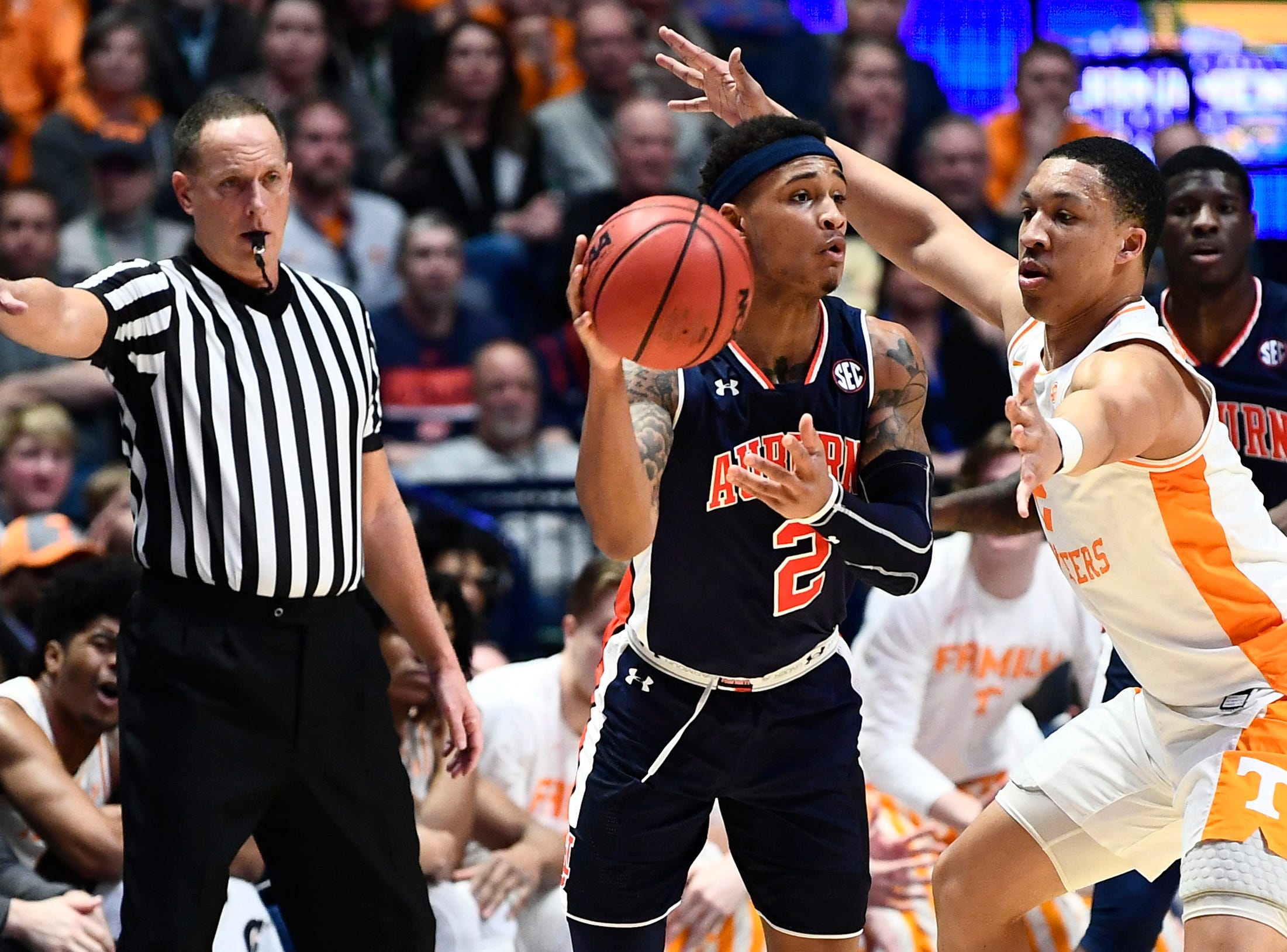 Auburn guard Bryce Brown (2) looks to pass while defended by Tennessee forward Grant Williams (2) during the first half of the SEC Men's Basketball Tournament championship game at Bridgestone Arena in Nashville, Tenn., Sunday, March 17, 2019.