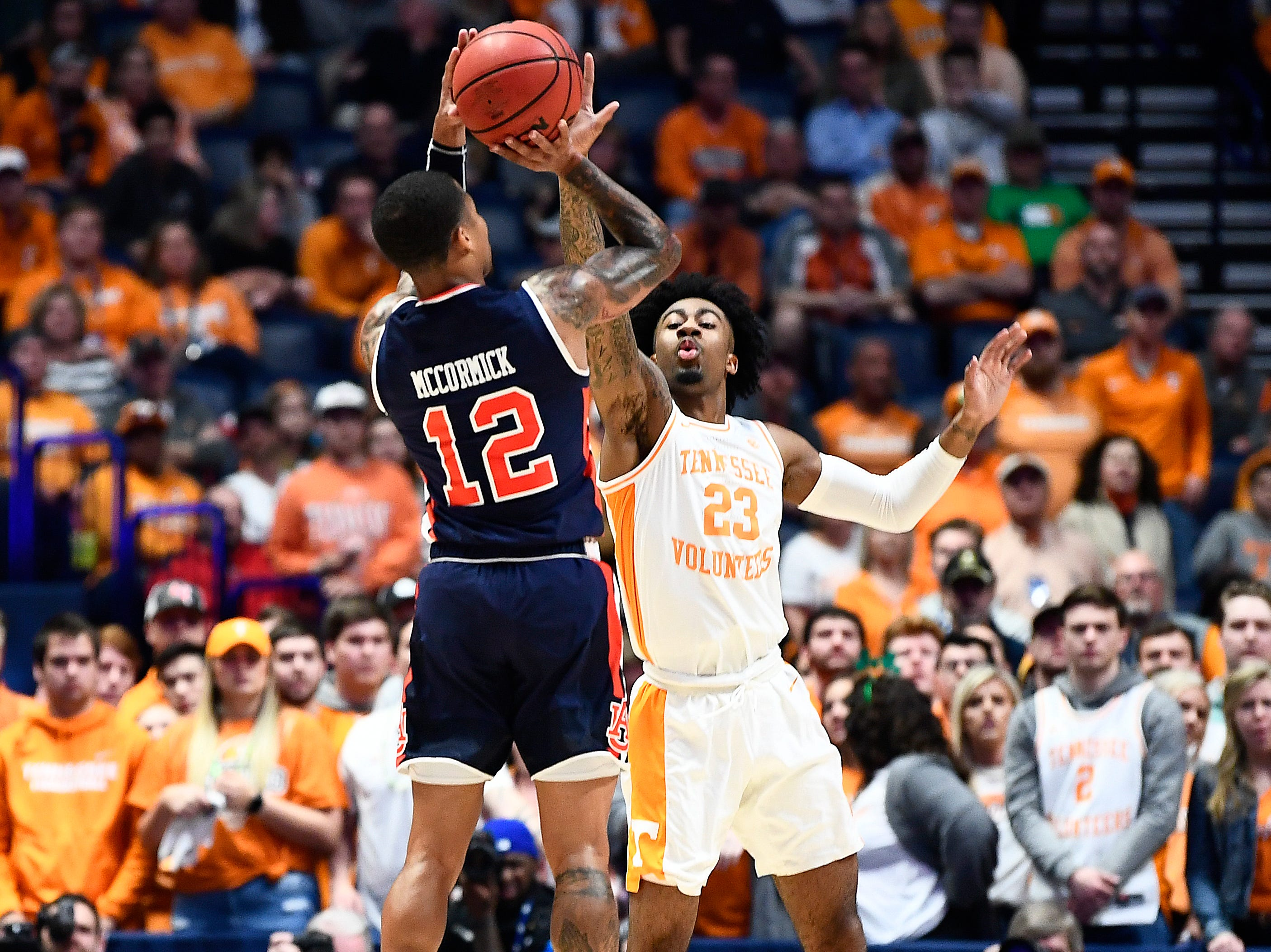 Tennessee guard Jordan Bowden (23) defends Auburn guard J'Von McCormick (12) during the first half of the SEC Men's Basketball Tournament championship game at Bridgestone Arena in Nashville, Tenn., Sunday, March 17, 2019.