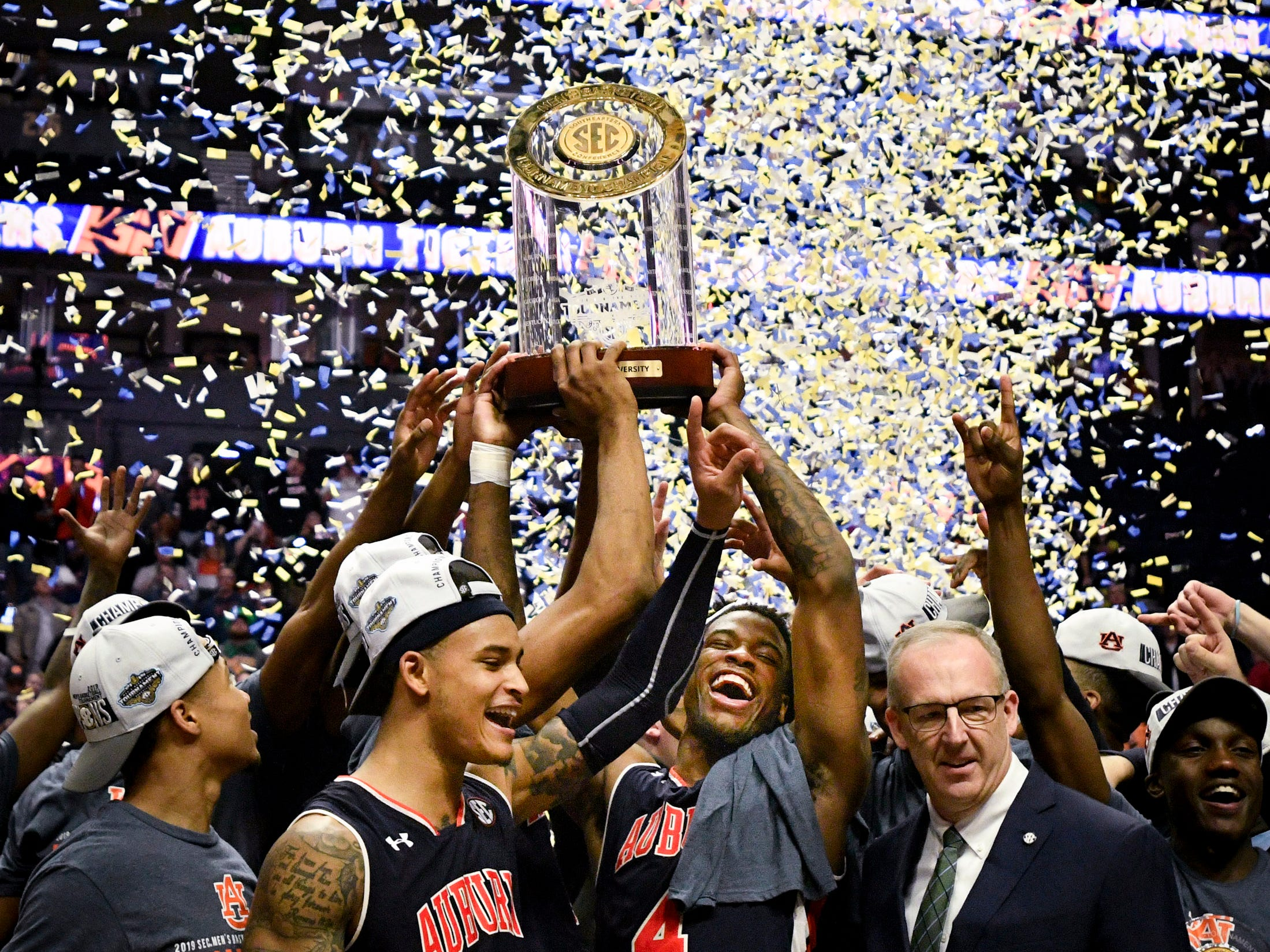 Auburn celebrates after their SEC Men's Basketball Tournament championship victory against Tennessee at Bridgestone Arena in Nashville, Tenn., Sunday, March 17, 2019.