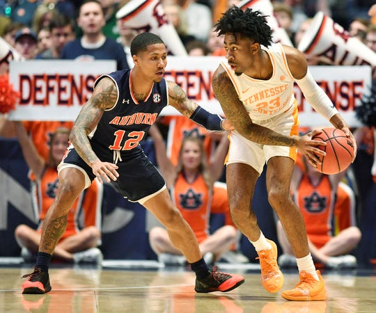 Tennessee guard Jordan Bowden (23) moves the ball defended by Auburn guard J'Von McCormick (12) during the first half of the SEC Men's Basketball Tournament championship game at Bridgestone Arena in Nashville, Tenn., Sunday, March 17, 2019.
