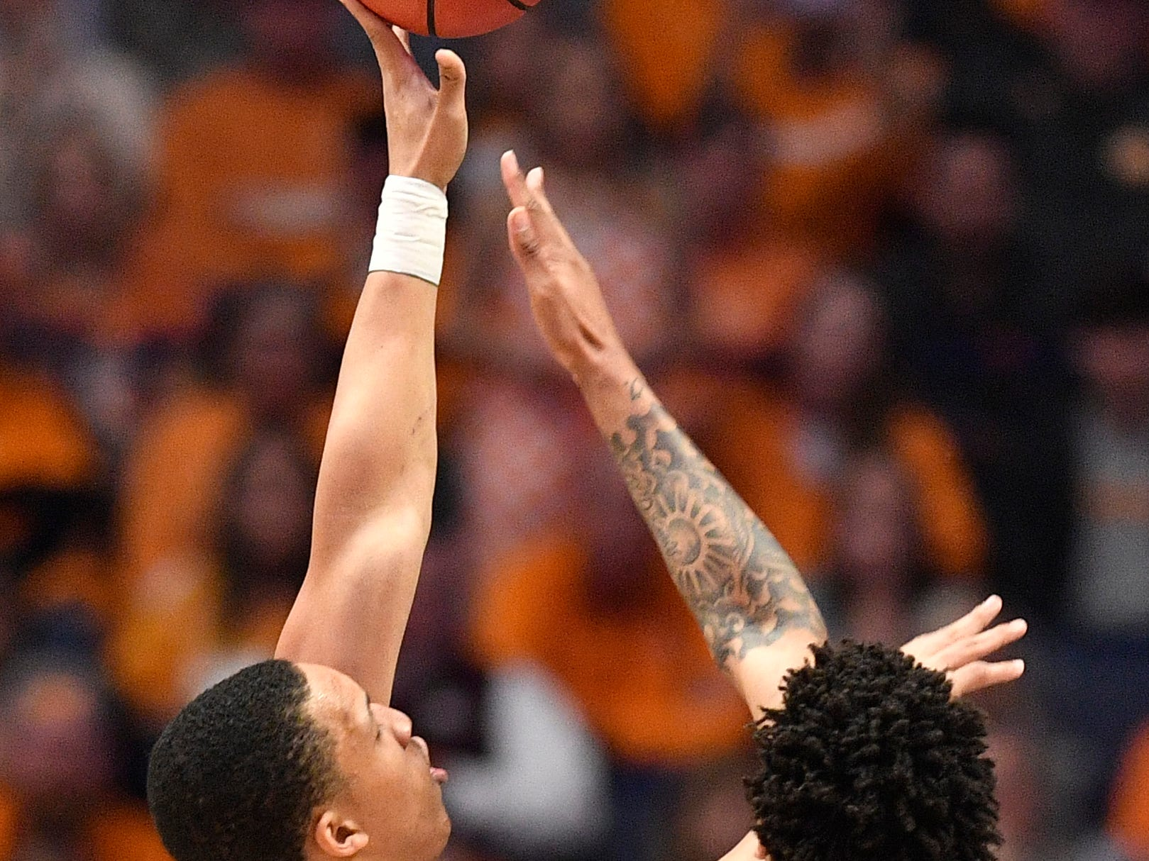 Tennessee forward Grant Williams (2) goes up for a shot against Auburn forward Chuma Okeke (5) during the first half of the SEC Men's Basketball Tournament championship game at Bridgestone Arena in Nashville, Tenn., Sunday, March 17, 2019.