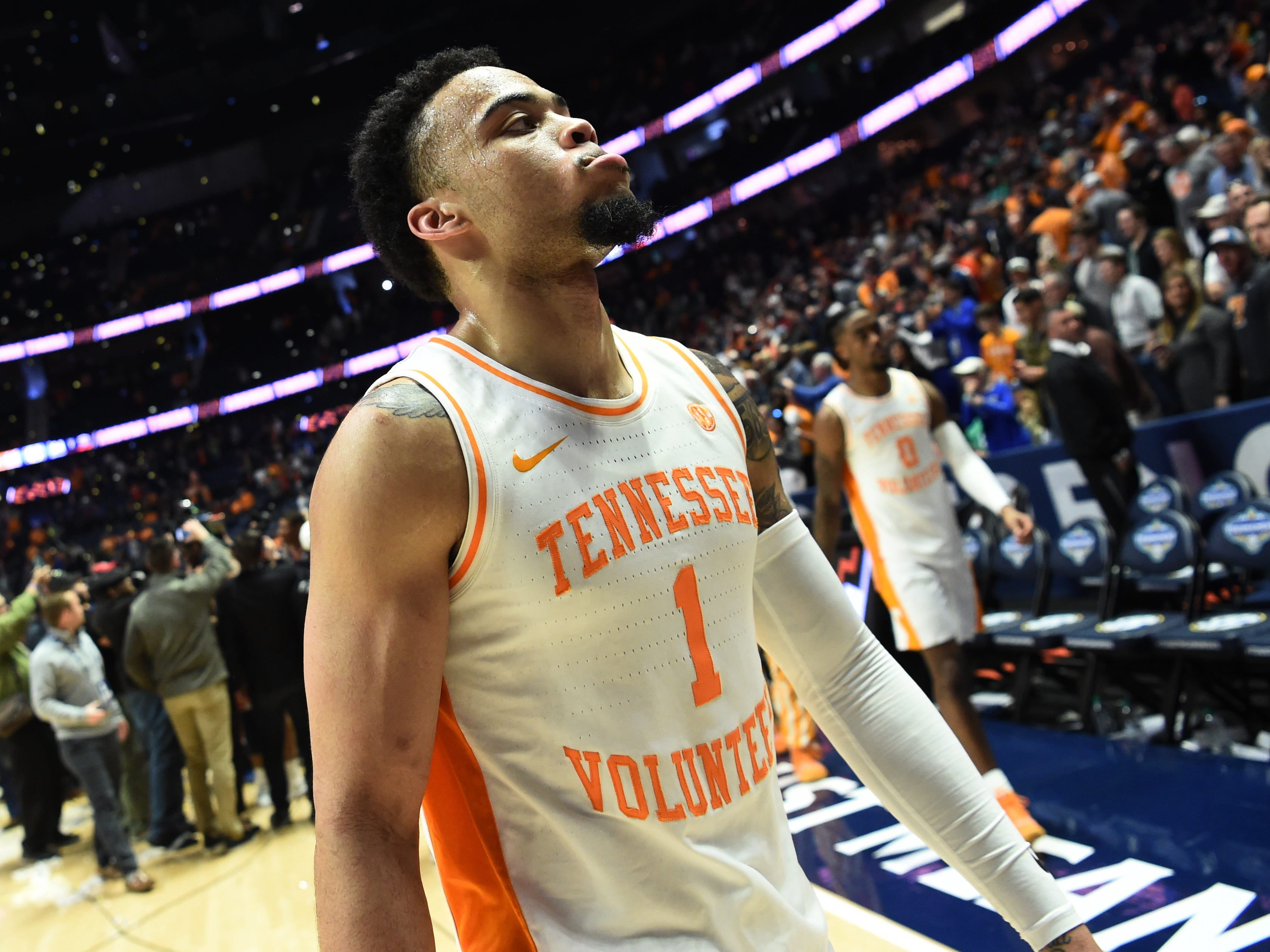 Tennessee guard Lamonte Turner (1) walks off the court after the team's loss to Auburn in the SEC Men's Basketball Tournament championship game at Bridgestone Arena in Nashville, Tenn., Sunday, March 17, 2019.