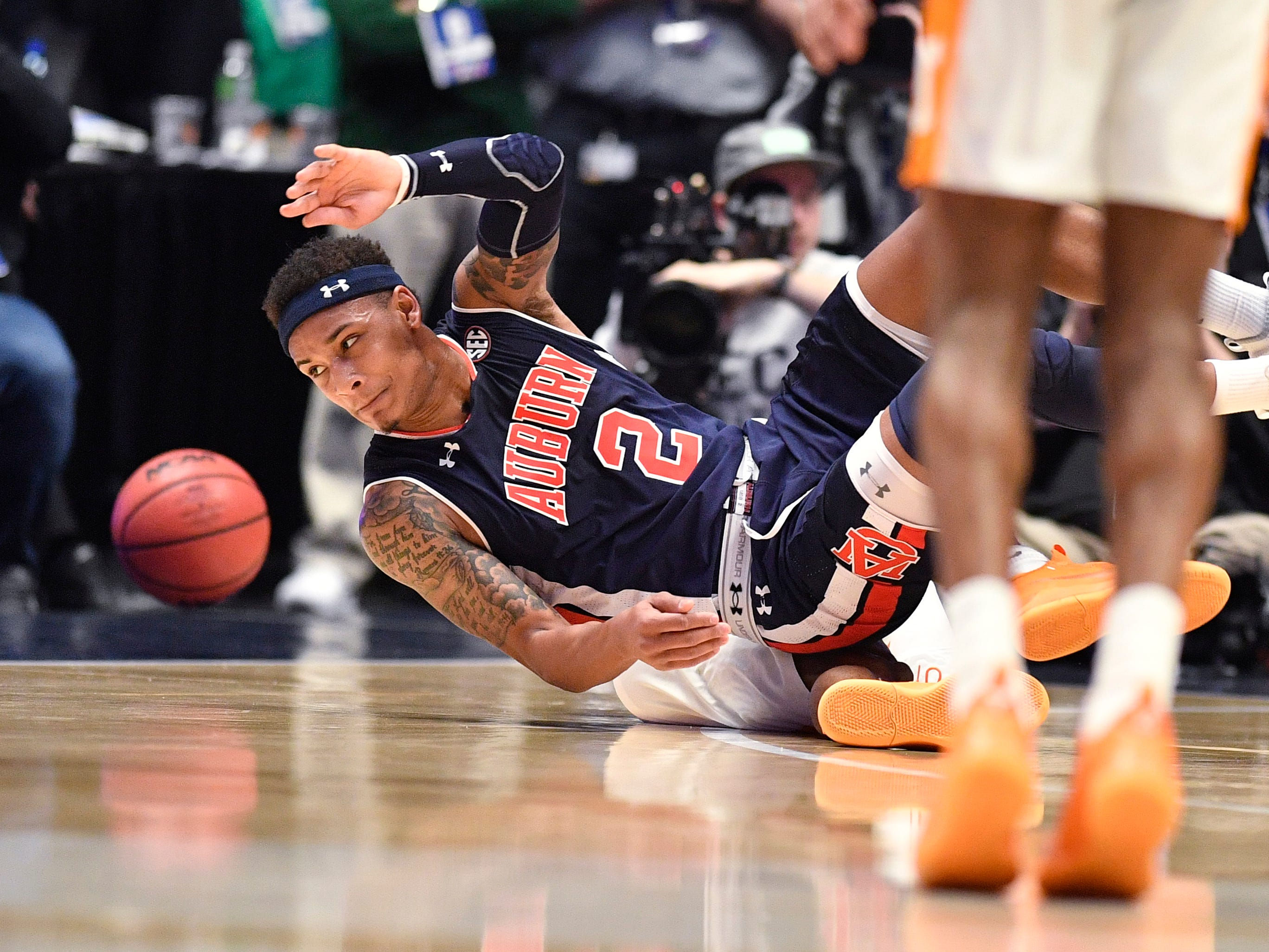 Auburn guard Bryce Brown (2) reaches for a loose ball during the first half of the SEC Men's Basketball Tournament championship game against Tennessee at Bridgestone Arena in Nashville, Tenn., Sunday, March 17, 2019.