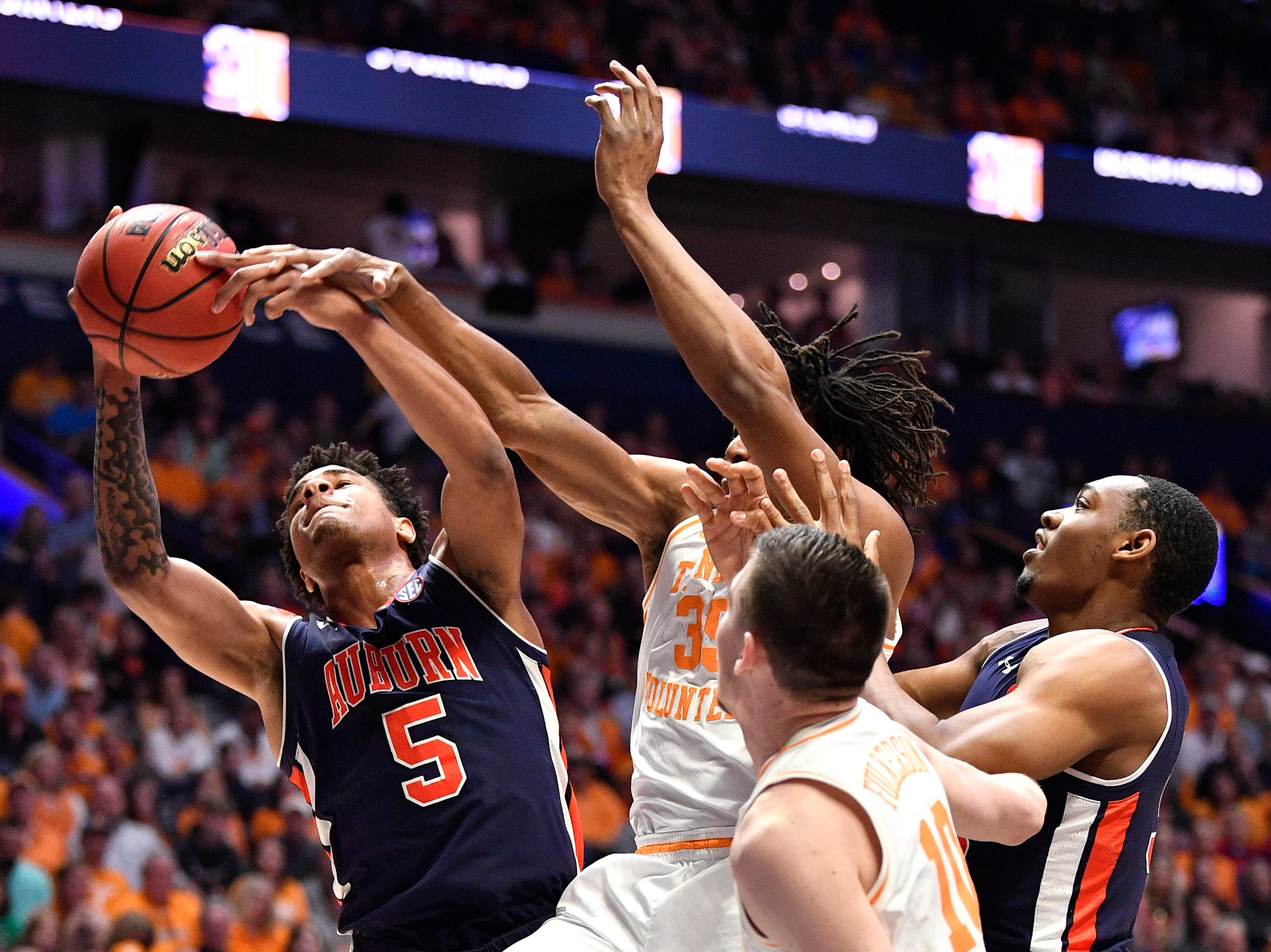 Auburn forward Chuma Okeke (5) comes down with a rebound defended by Tennessee guard/forward Yves Pons (35) during the first half of the SEC Men's Basketball Tournament championship game at Bridgestone Arena in Nashville, Tenn., Sunday, March 17, 2019.