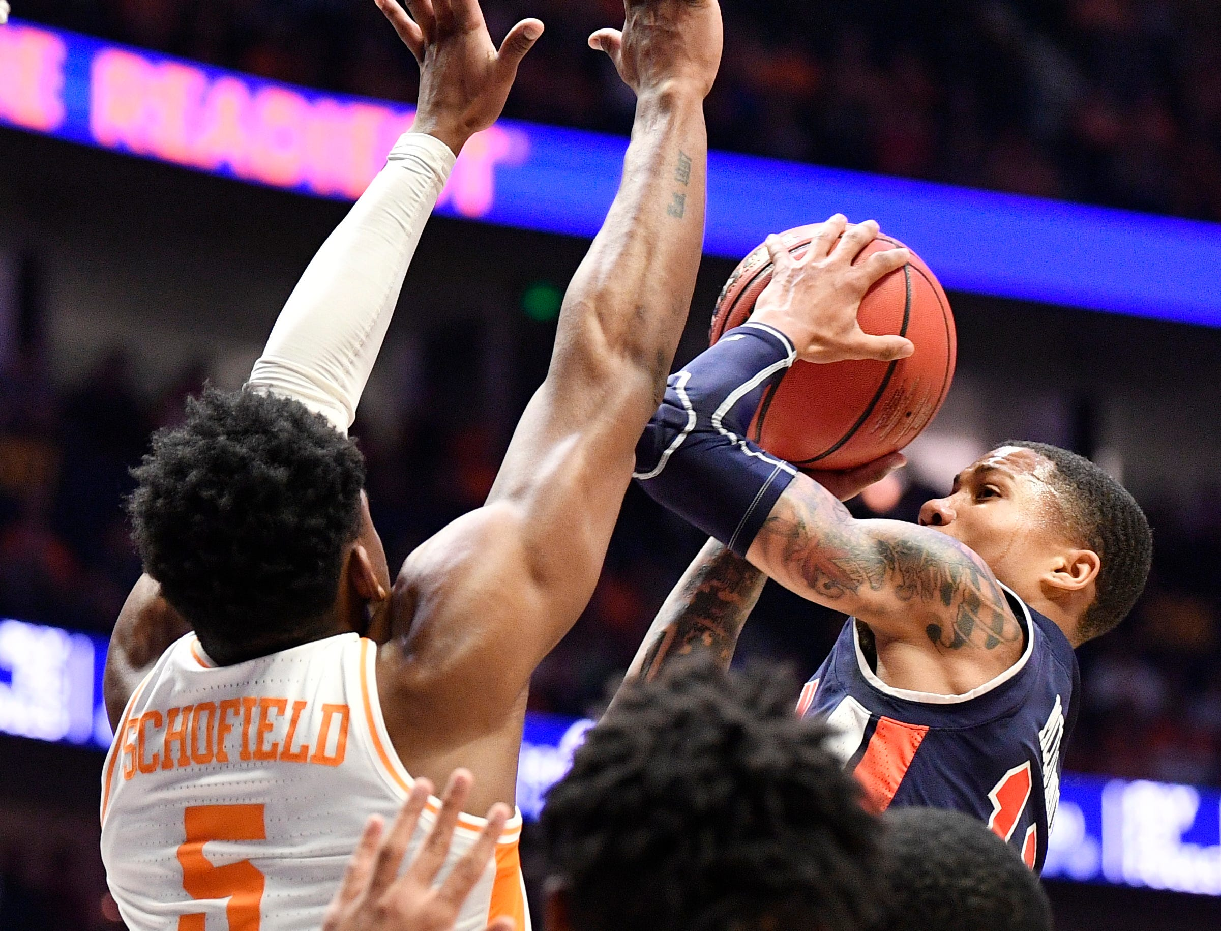 Auburn guard J'Von McCormick (12) goes up for a shot defended by Tennessee guard Admiral Schofield (5) during the first half of the SEC Men's Basketball Tournament championship game at Bridgestone Arena in Nashville, Tenn., Sunday, March 17, 2019.
