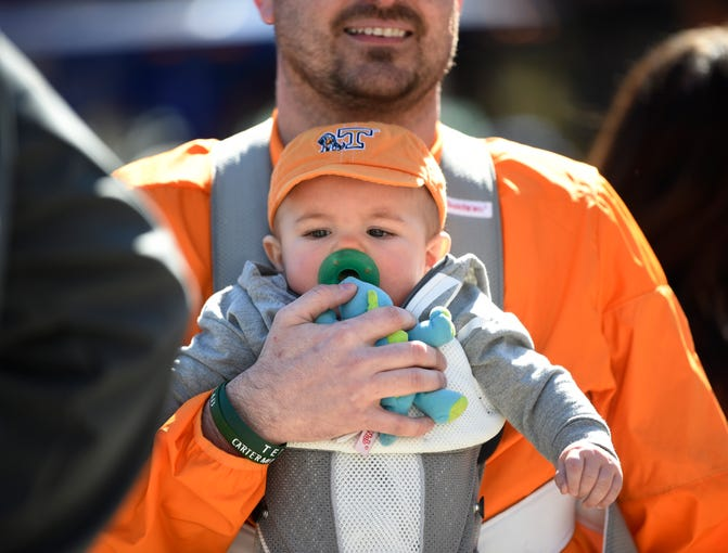Ricky Howell of Knoxville holds his son Cason, 6 months, before the SEC Men's Basketball Tournament championship game outside Bridgestone Arena in Nashville, Tenn., Sunday, March 17, 2019.
